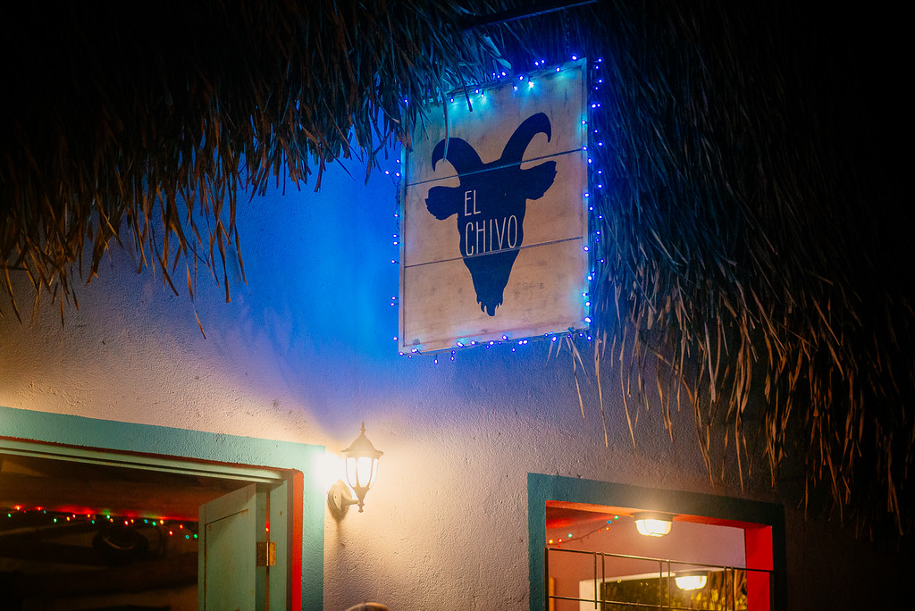 Chivo sign at night