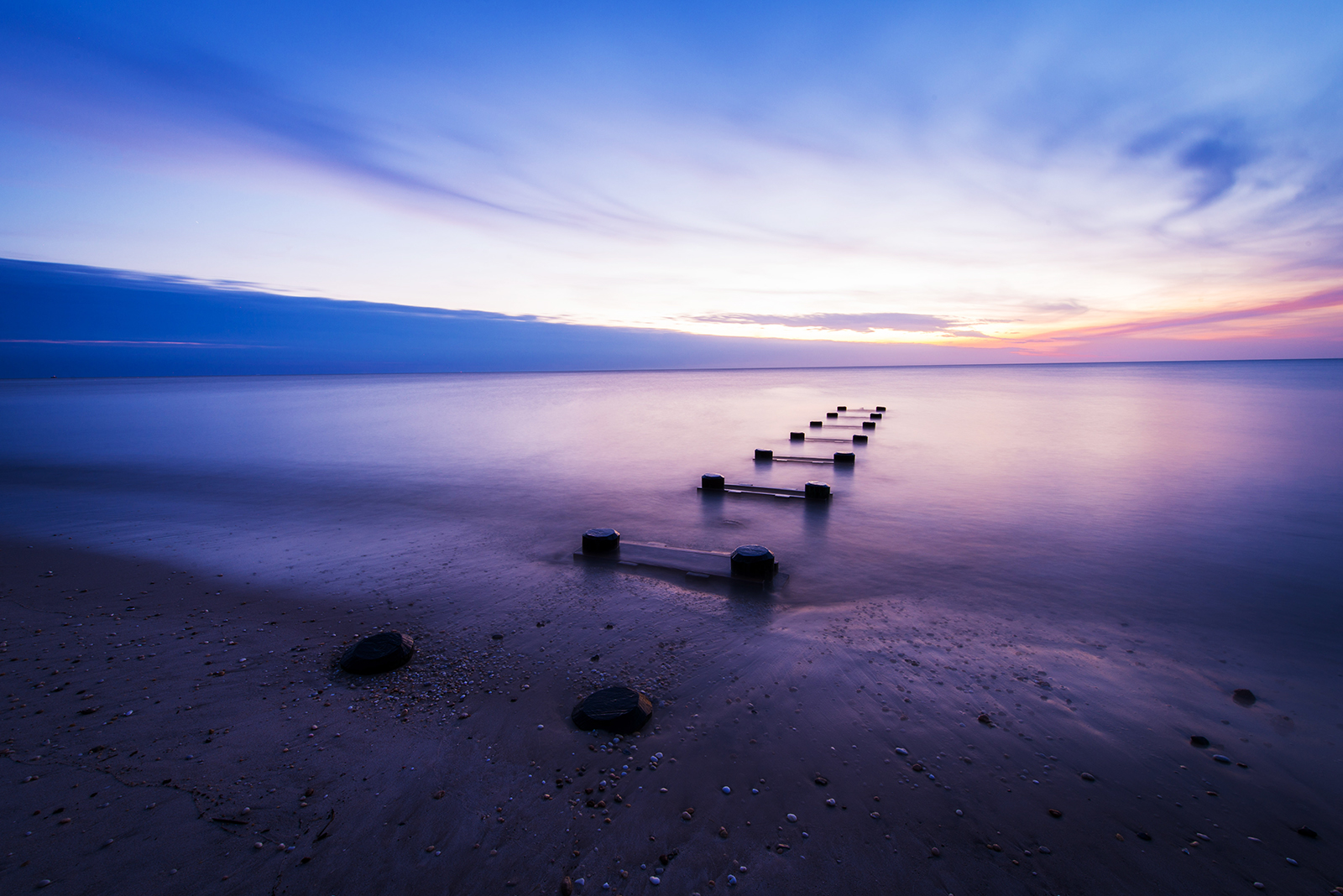 Pilings at sunset on Cape May, NJ © Allie Richards