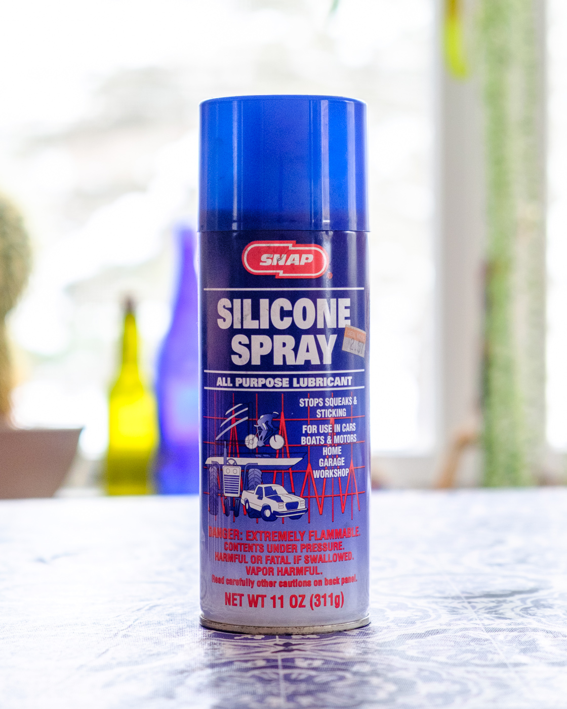 I must have bought this bottle of SNAP Silicone Spray 20 years ago. It's still working, but this brand has since been discontinued. You can find many similar alternatives at your local automotive supply store...