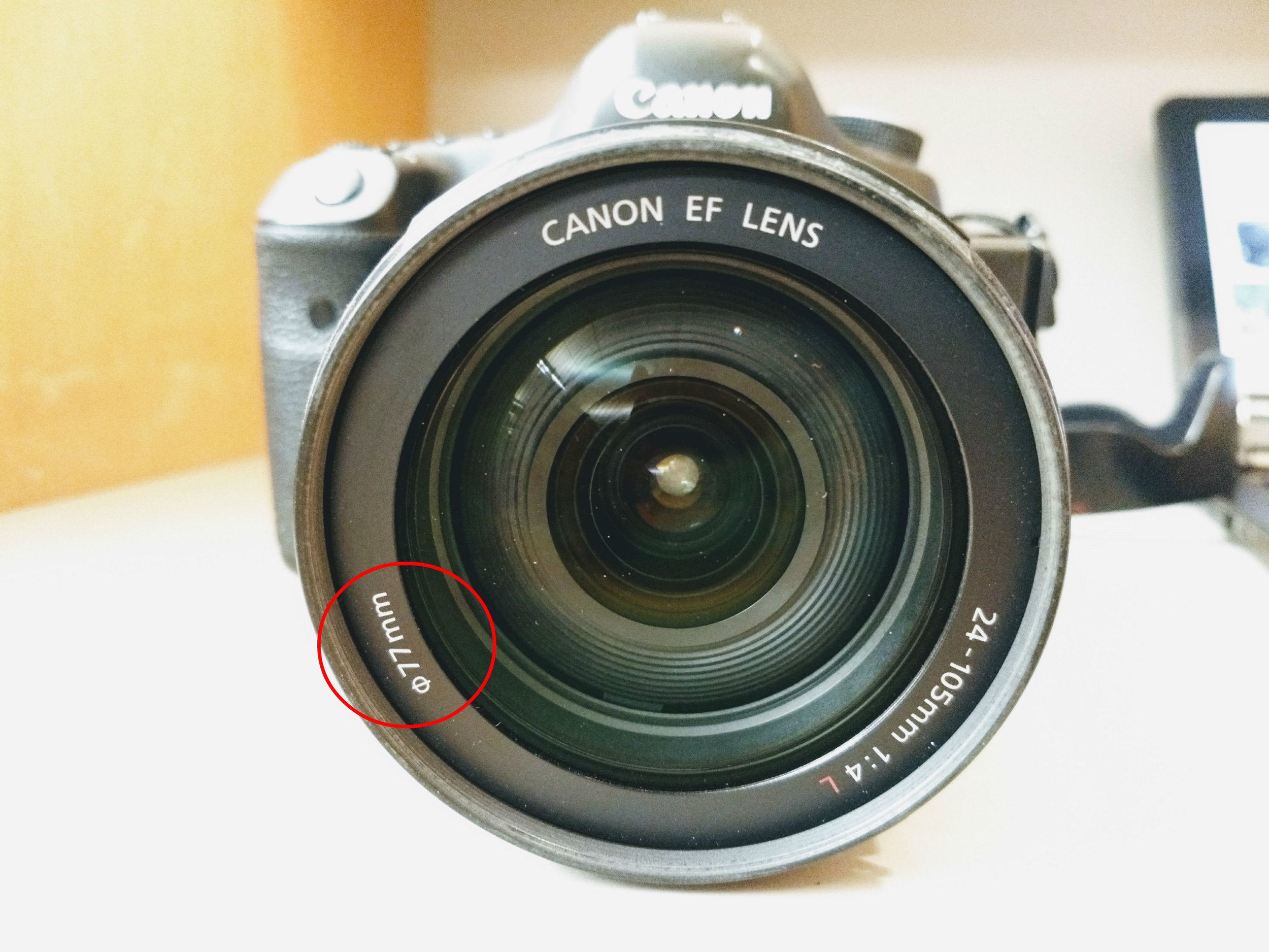 """Make sure you purchase the correct size for each lens, which is the """"thread size."""" The size is generally found on the inner rim of the lens near the glass, the bottom of the lens near the serial number, or on the back of your lens cap. Look for the little circle with the hashmark through it like this one."""