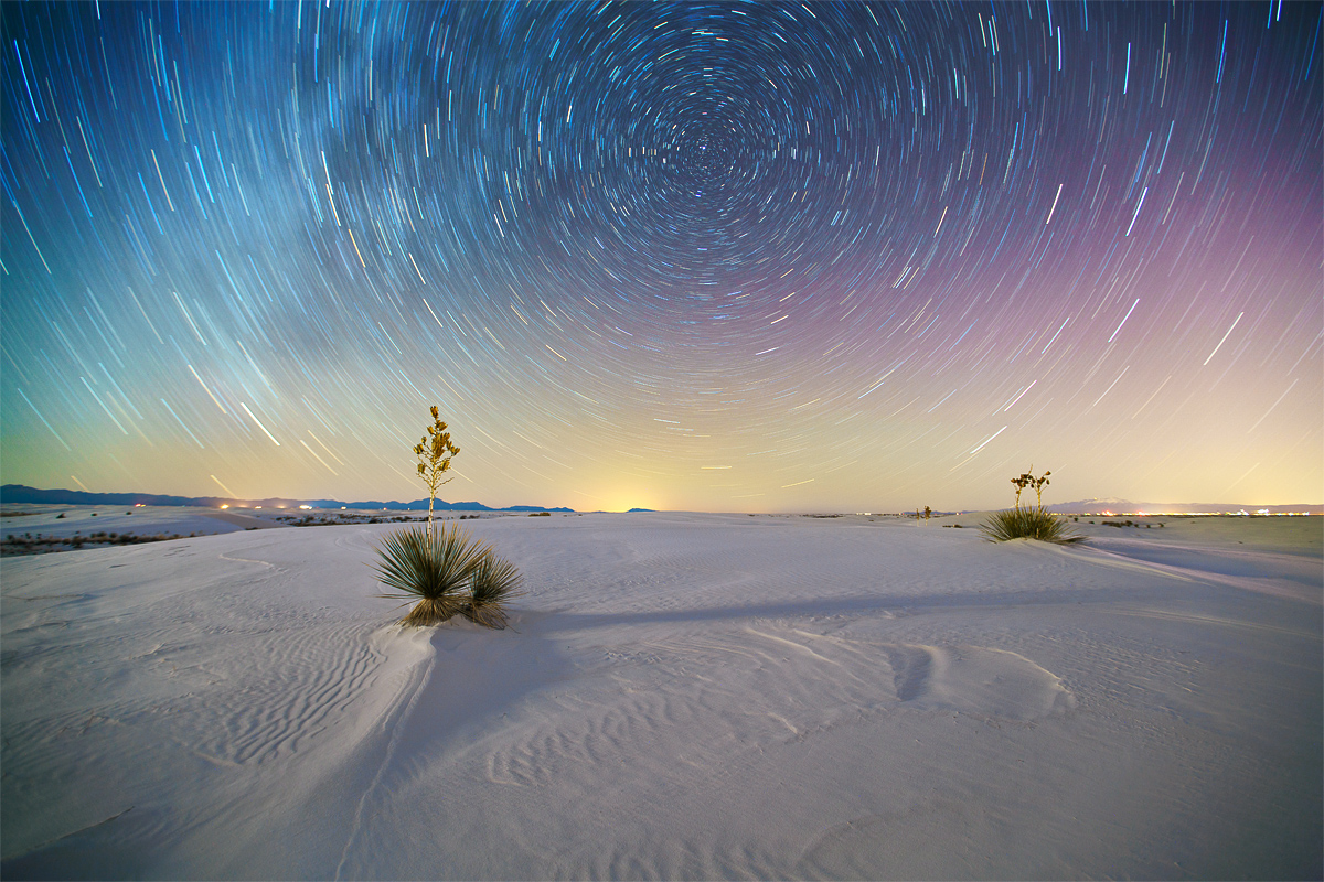 """When the North Star (Polaris) is included in the composition, the star trails form circles. Polaris remains in a fixed position over the north pole of the earth, so it appears to stay still, while the other stars """"orbit"""" around it over time. This shot is made over 25 minutes - people are always shocked to find out how much the earth moves over this amount of time!"""
