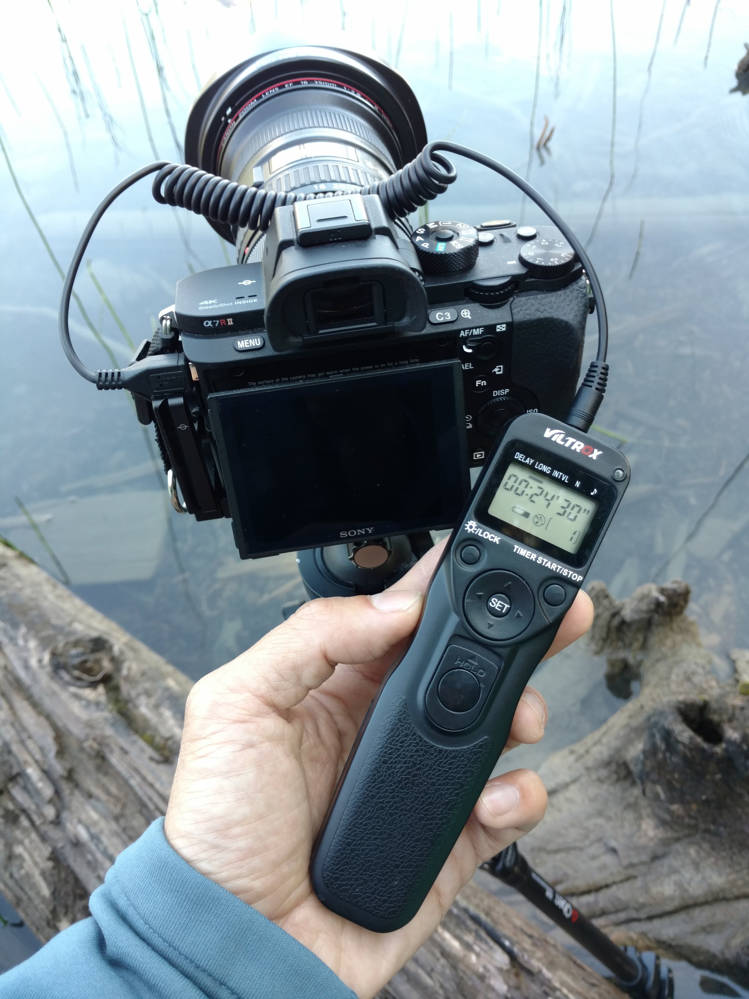 """Aside from your camera, lens, and tripod, an essential piece of gear for doing star trails is a locking remote shutter release cable, preferably with a built-in programmable timer. This allows you to keep your camera shutter open in """"bulb"""" mode, and walk away while your you shoot as many exposures as you want for as long as you want."""