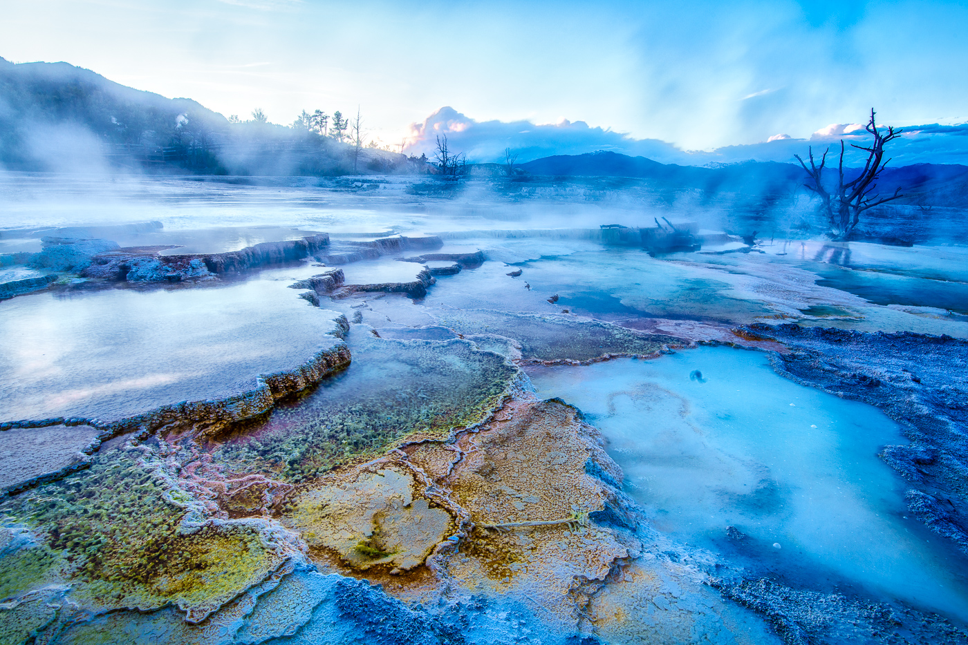 One of our favorite locations is Mammoth Hot Springs because you can make all kinds of great, abstract compositions. Add in the blue hour for something really special! © Paul Nguyen