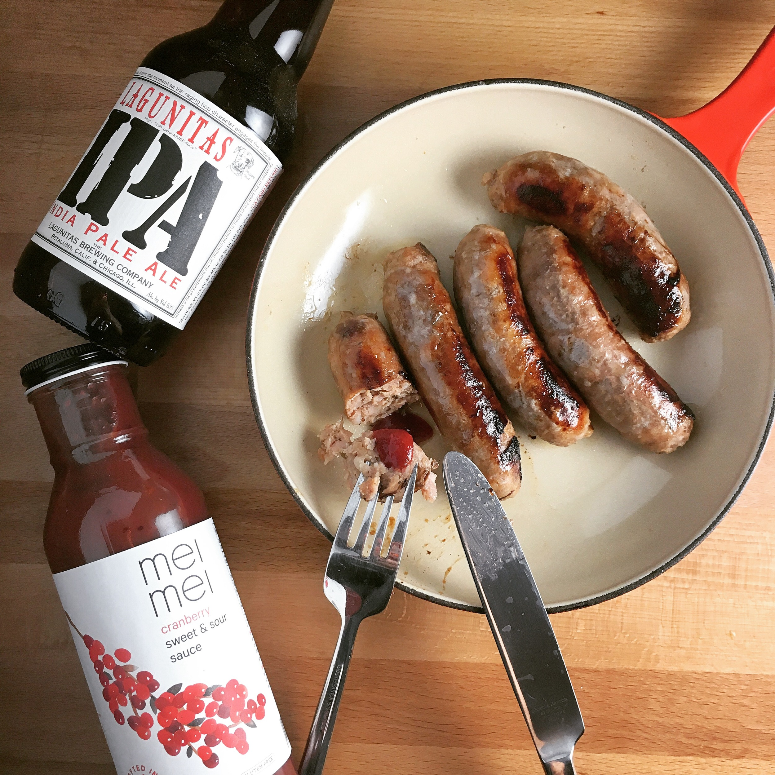 beer poached sausages with cranberry sweet and sour sauce.