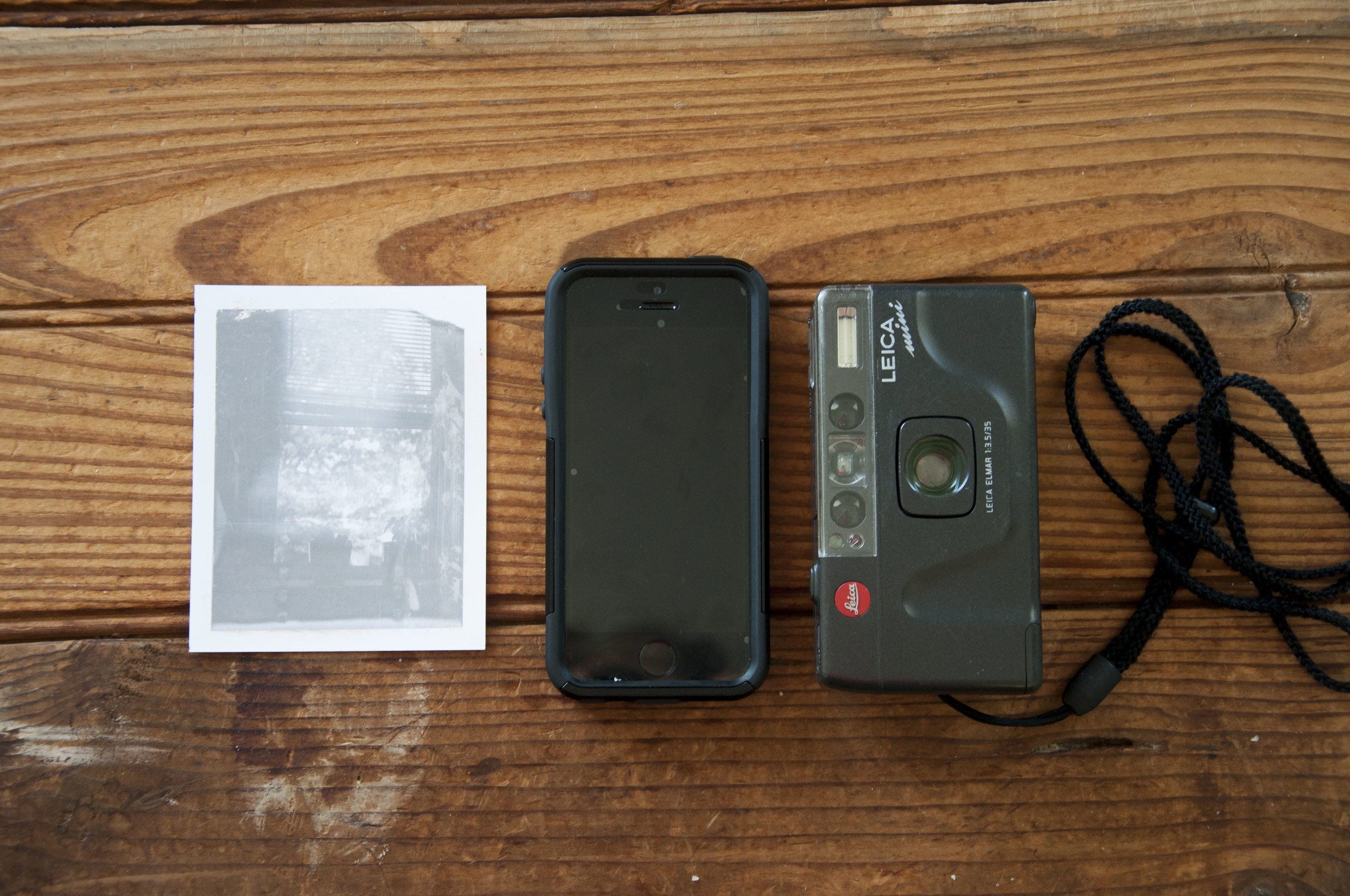 For size comparison, Polaroid Type 107 3 1/4x4 1/4 iPhone 5s and then the Leica mini