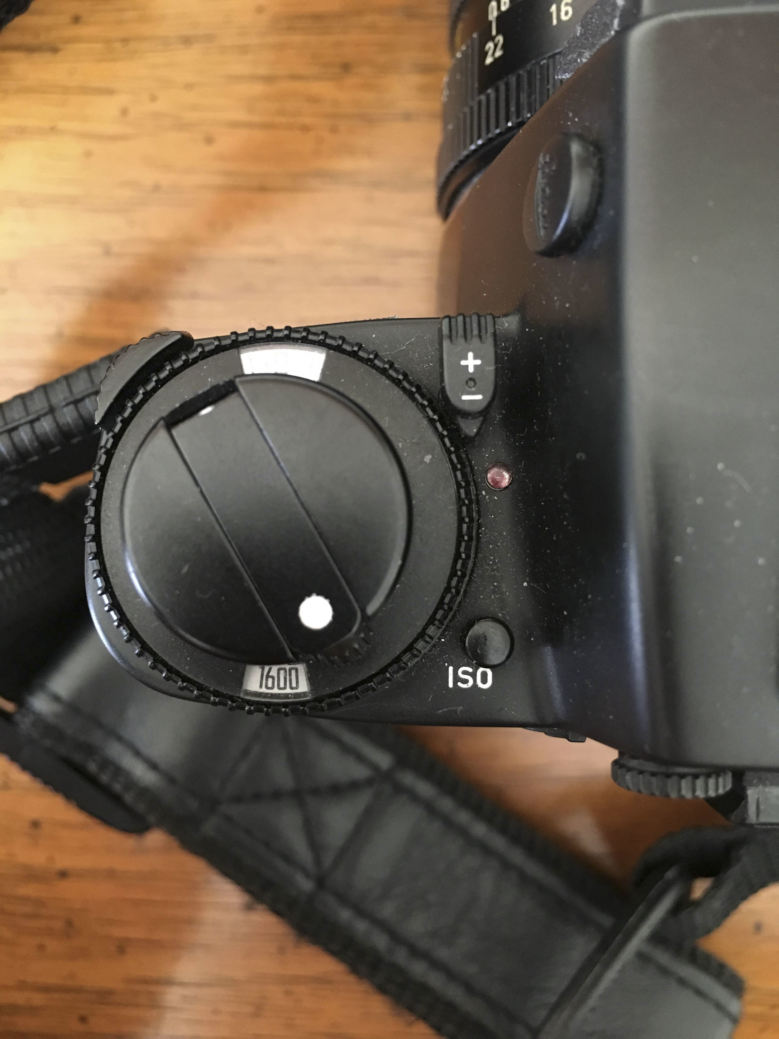 to adjust the iso you have to hold down the iso button and twist the dial to desired iso.  To operate the exposure compensation dial you move the +/- to down and to side and then move the switch on the top left of the dial to move the wheel.