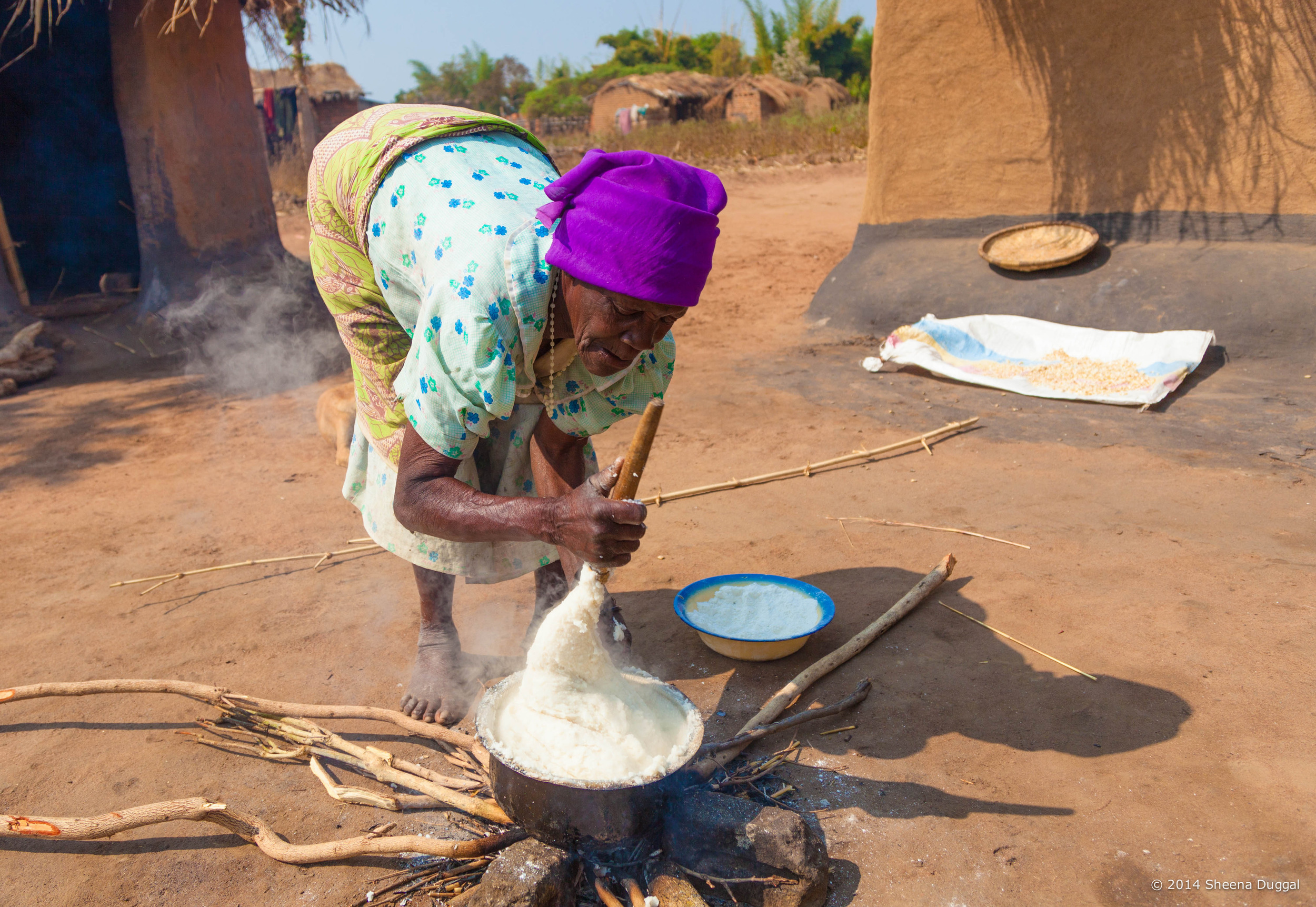 Old Lady cooking, Malawi