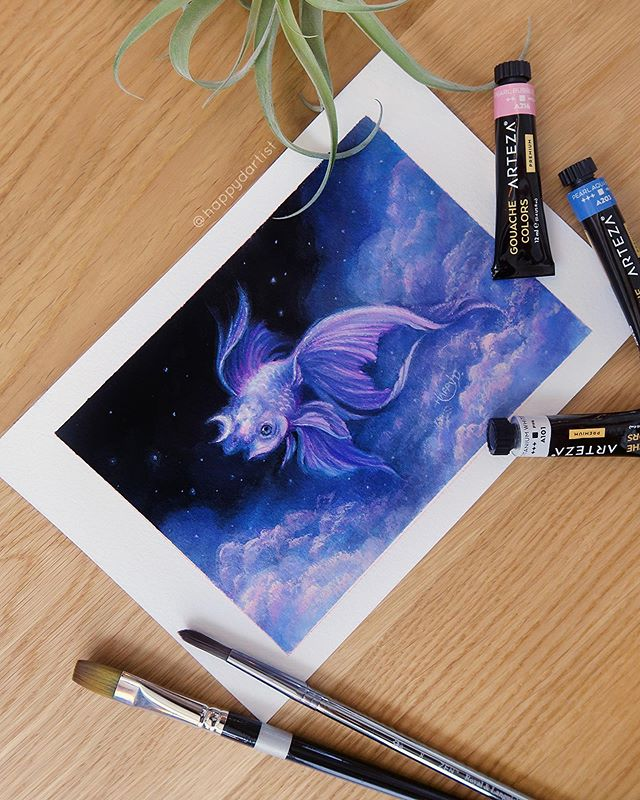 My first official gouache painting featuring a cute magical sky fish 💜💙💖 I really enjoyed experimenting with this new medium, which feels like the perfect lovechild of watercolors and acrylic 🎨🐠 I am going to be doing another gouache painting during today's Patreon livestream (available to all $1 and higher patrons 👉 patreon.com/happydartist) 😀😘 . 🐟 Original & prints are up in my shop (🔗 IN BIO) 🐟 . . . . . . #gouache #painting #portrait #varnish #oddlysatisfying #asmr #satisfyingvideos #instavideo #artistsoninstagram #artistsofinstagram #oil #oils #surreal #fantasy #acrylic #drawing #video #realism #semirealism #magical #watercolor #coloredpencil #oilpainting #stars #galaxy #nightsky #moon #goldfish #fancygoldfish #fish