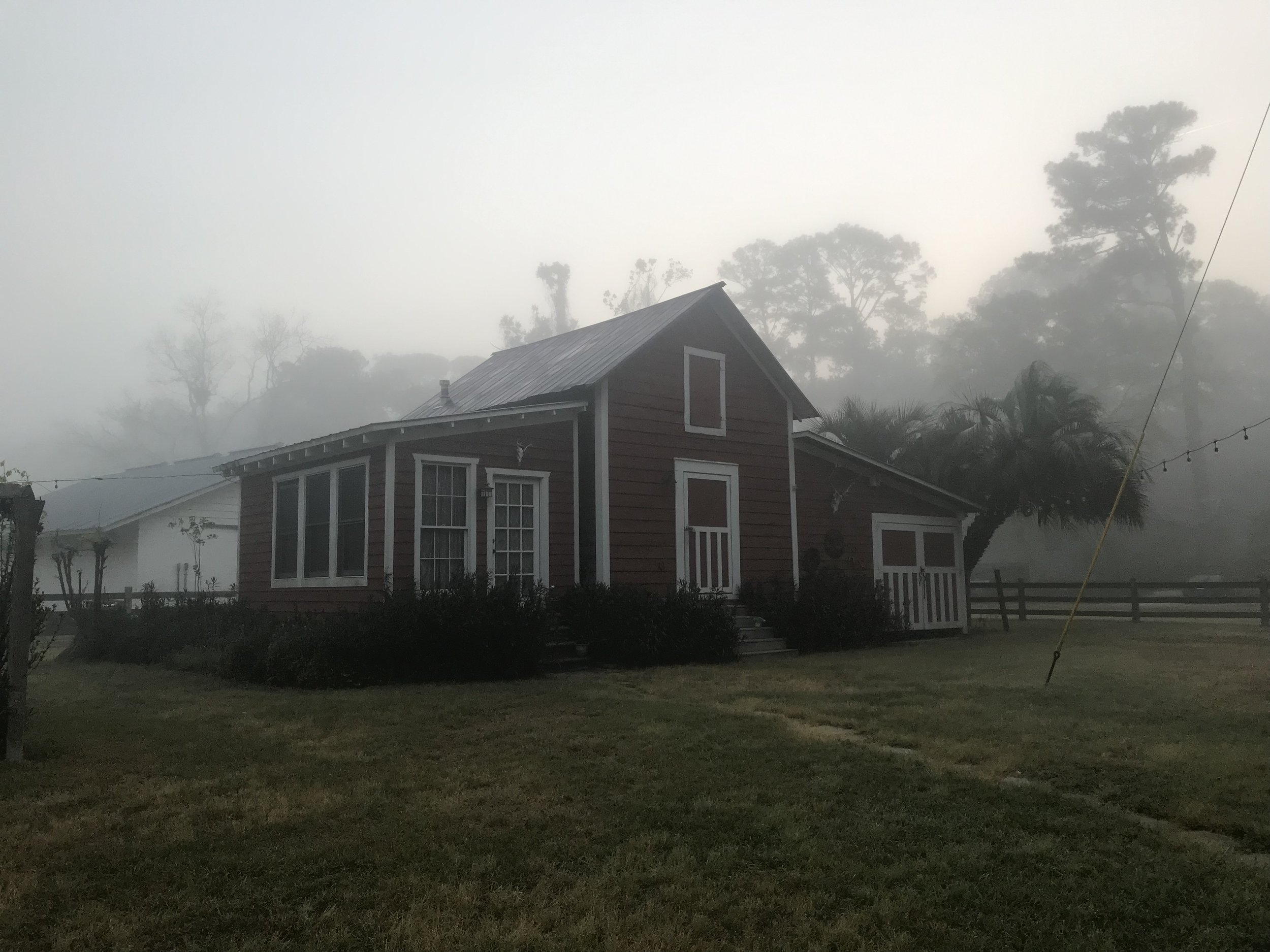 Red barn with morning mists.