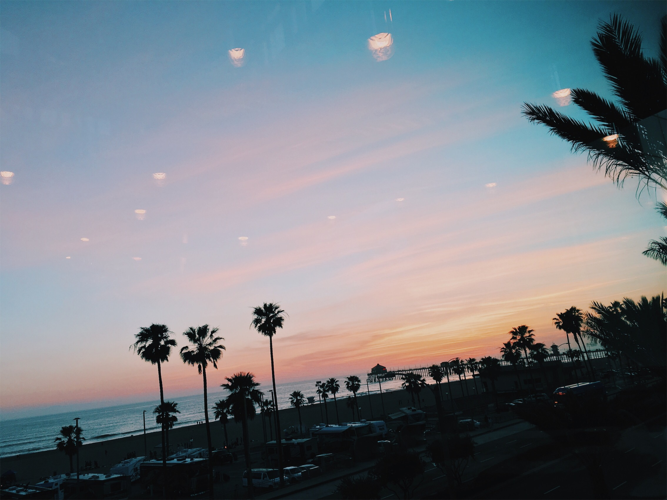 COASTAL CHEMTRAIL DISPERSAL HAZE AS SUNSET ENSUES 3/16/2017 — Huntington Beach, California