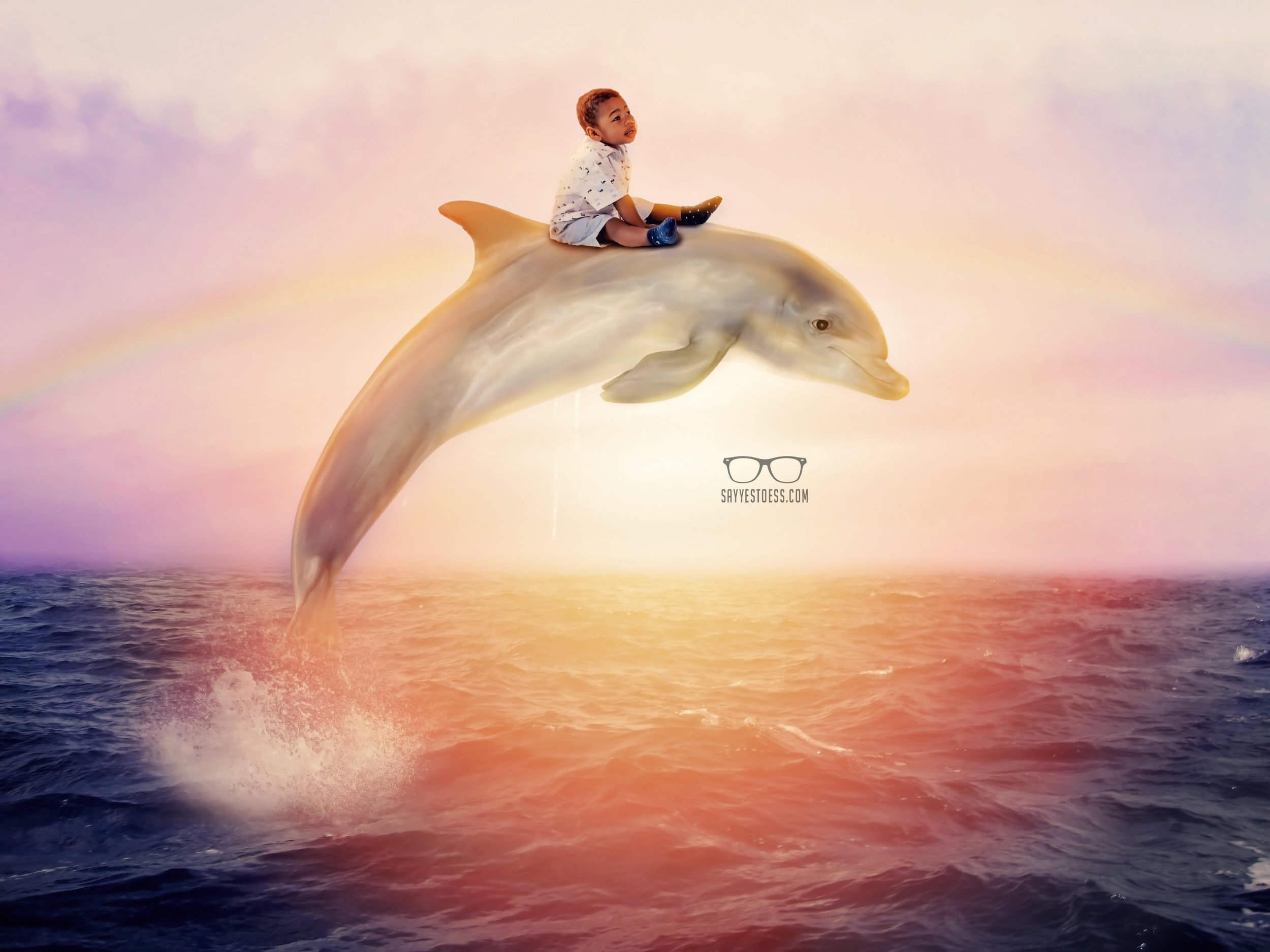 Portraits done for Ronald Mcdonald House In Cincinnati Ohio. Boy Rides on back of dolphin by Say Yes To Jess Cincinnati Ohio Family Photographer