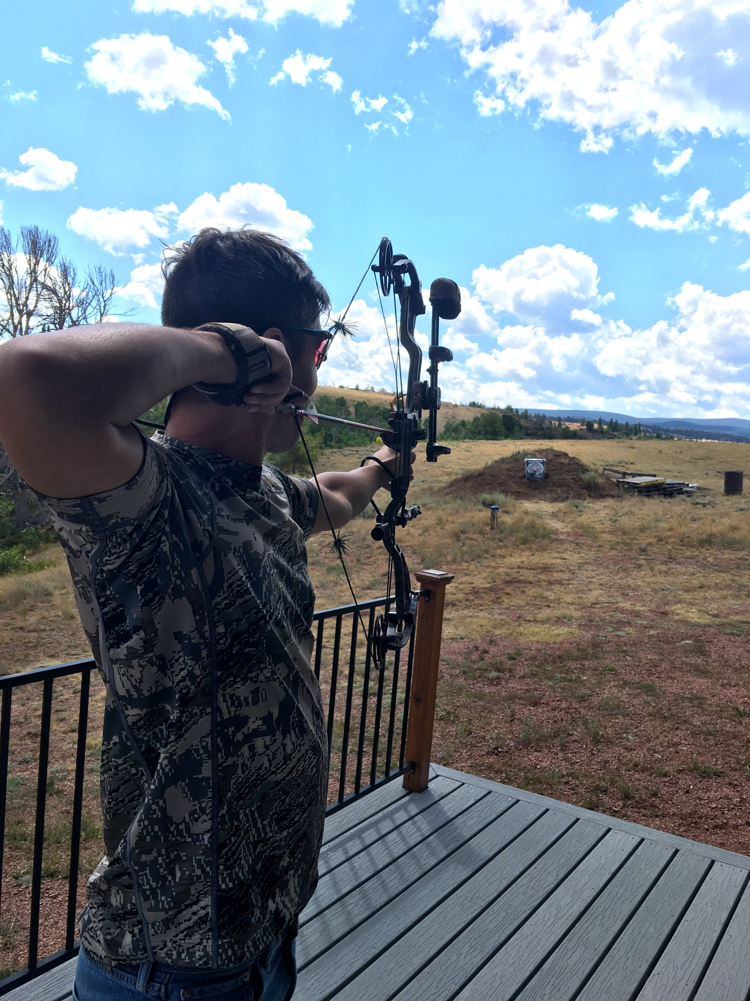 Ben practicing with his compound bow