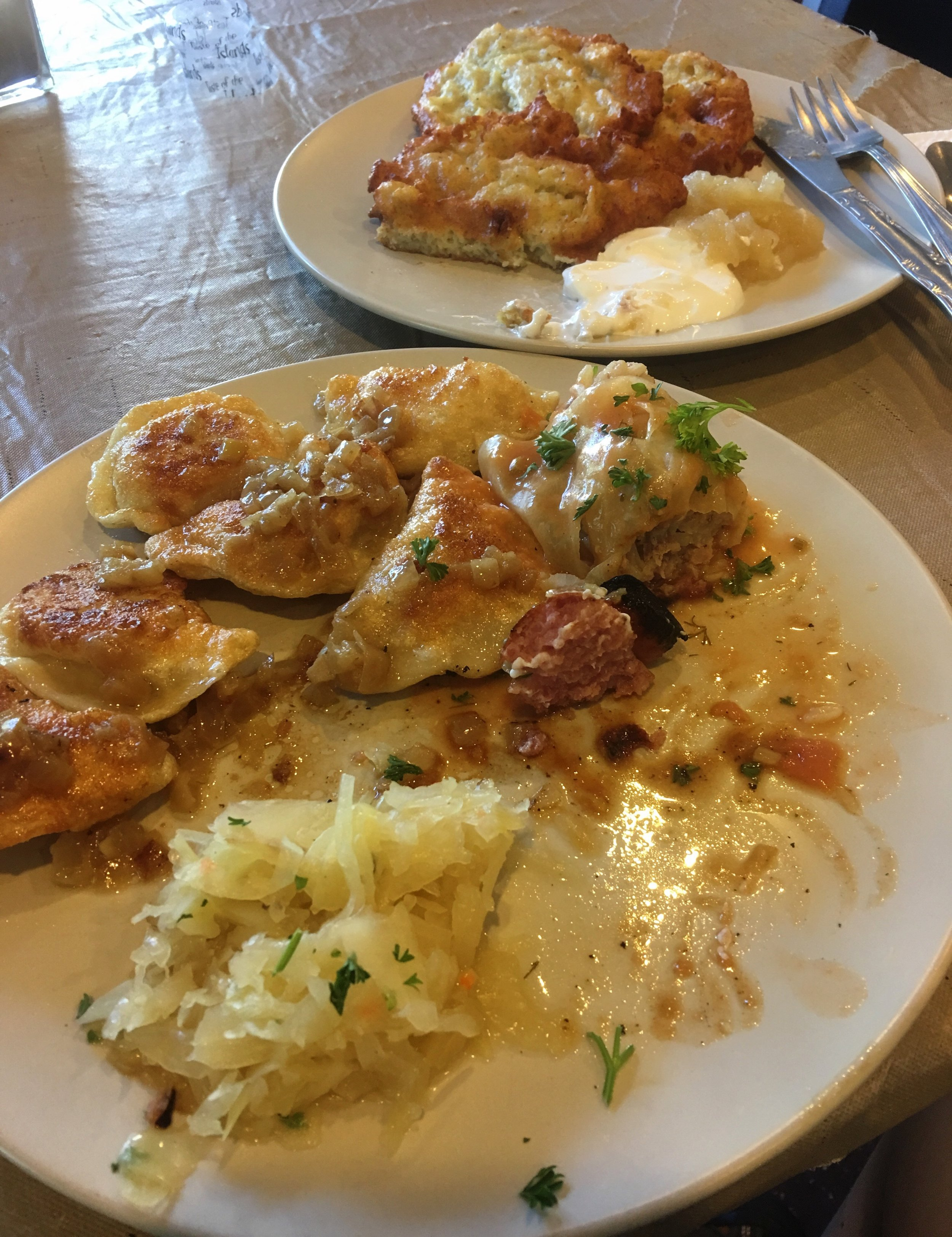 Homemade pierogis, sauerkraut, grilled kielbasa and potato pancakes with sour cream and applesauce