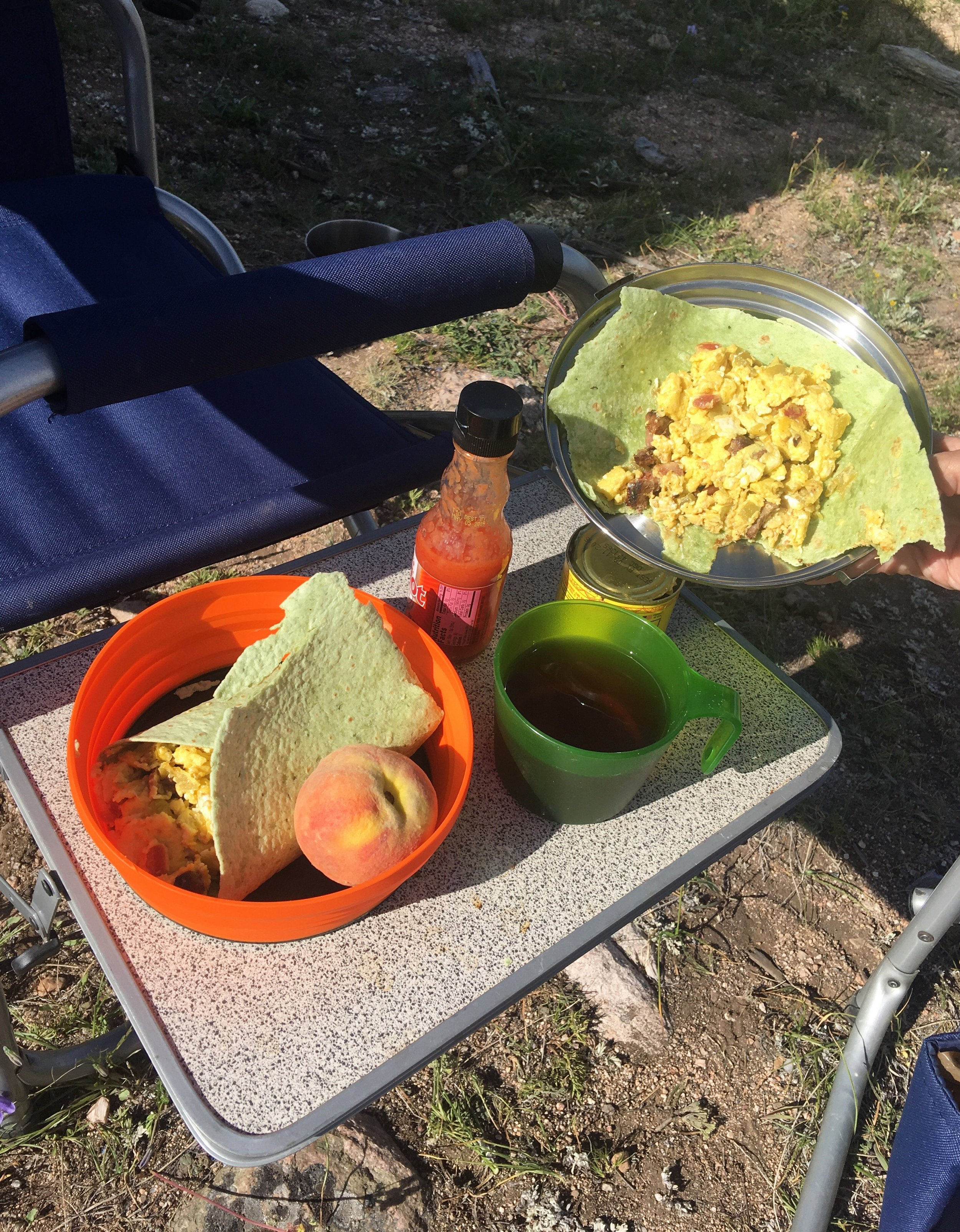 Camp Breakfast: breakfast burritos with eggs, chiles, diced steak and bacon, fresh Colorado Palisades Peaches, tea and coffee to fortify us for the adventures ahead.