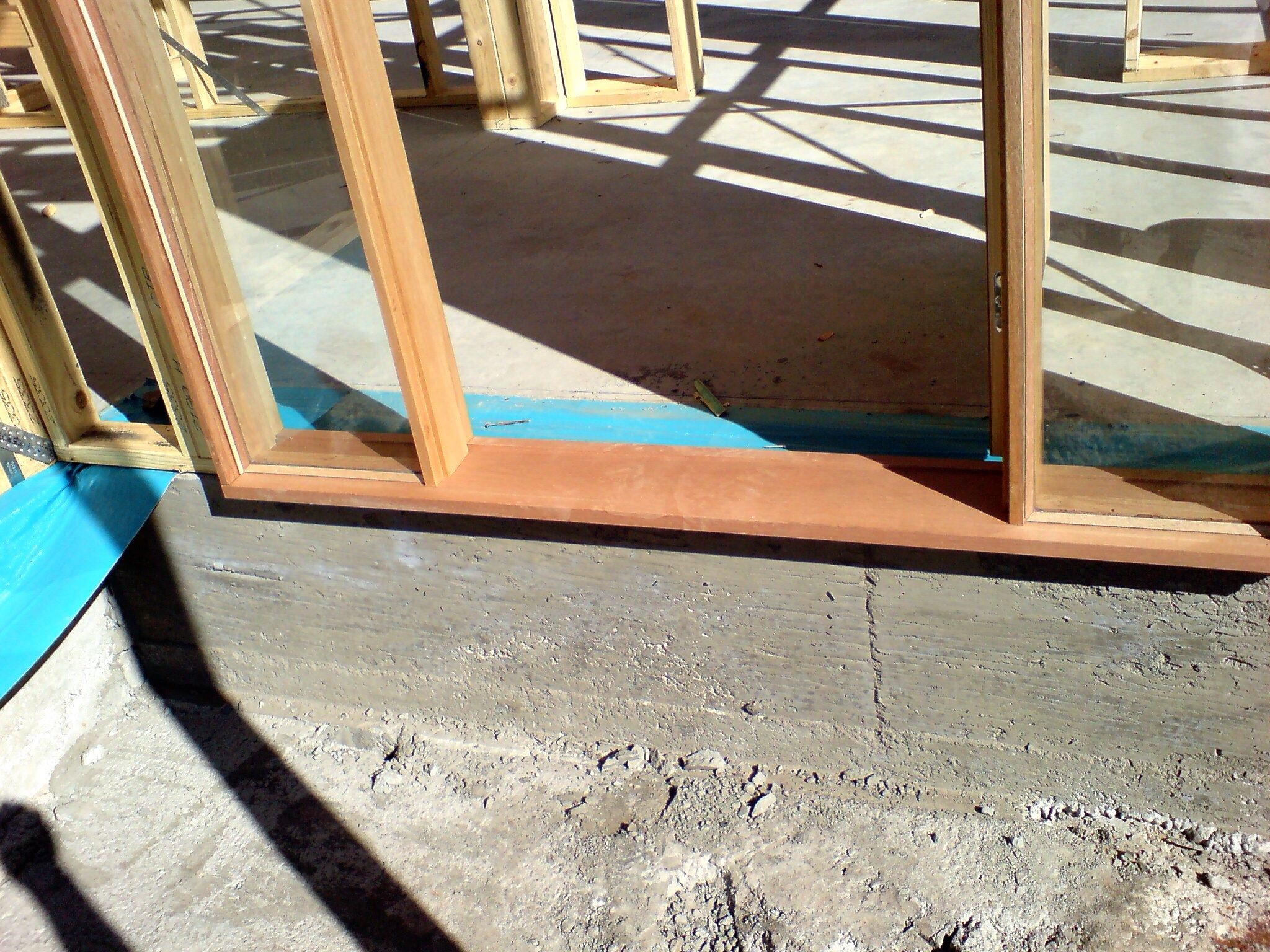 This barrier does not protrude below the doorway & frame. Remedial work would have to be done to correct this.