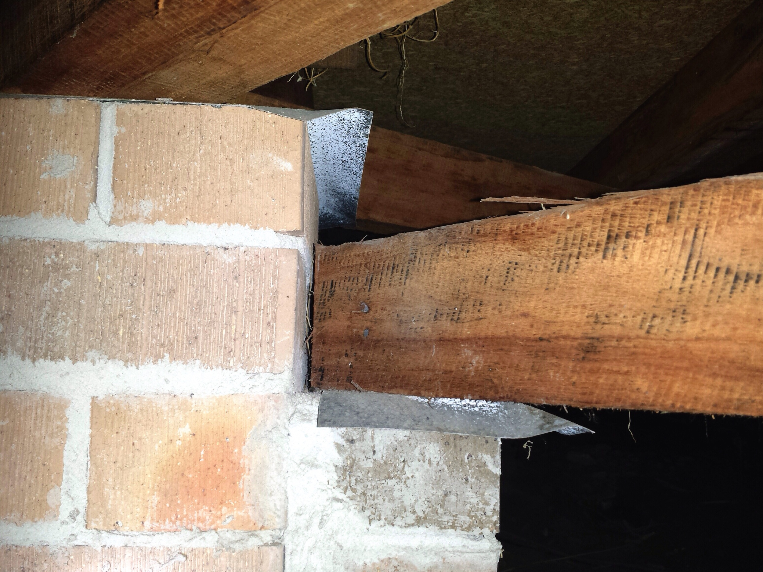 This is the most common failing of ant capping, failing to form a continuous barrier when there is a vertical transition, nothing is preventing the termites coming up between the two piers and into the lower bearer, and it would not be visible until it's too late.