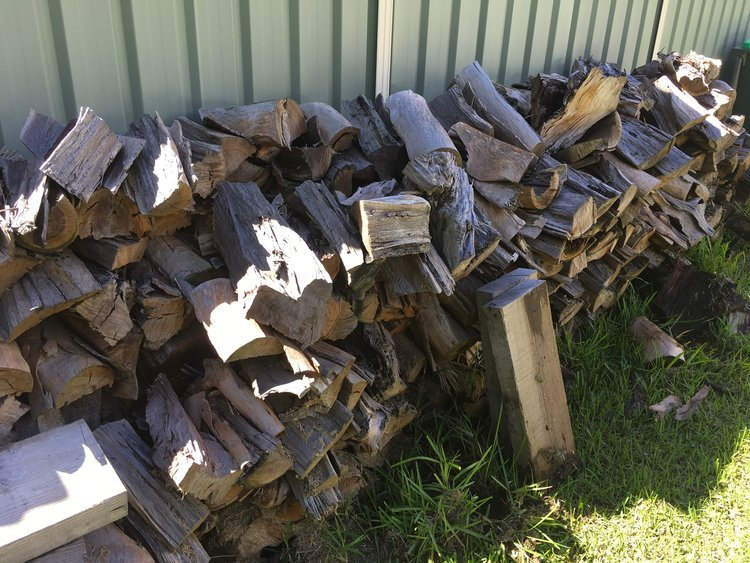 A large pile of lumber is a comforting sight before winter.