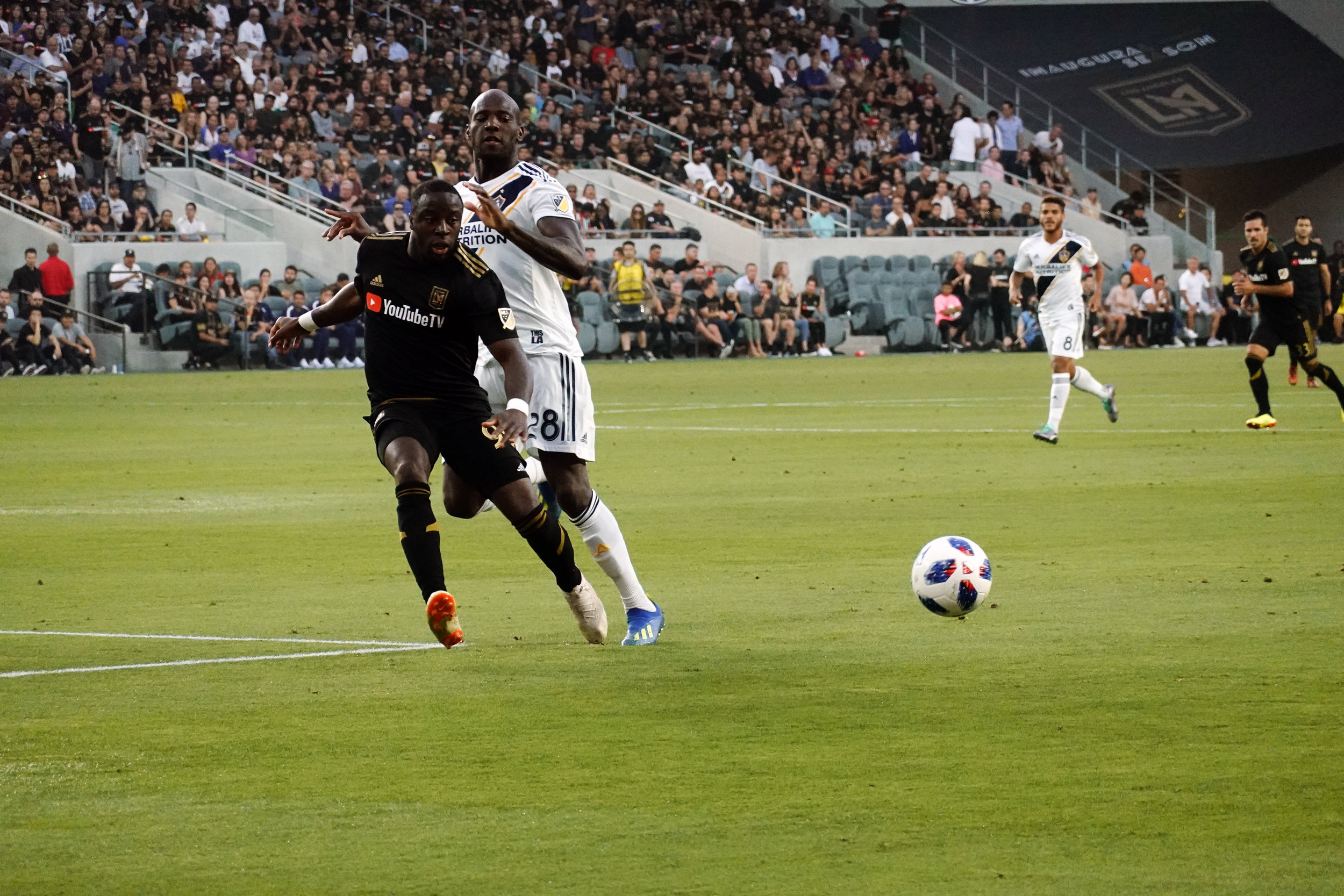 LAFCs Adama Diomande battles LA Galaxy defender, Michel Ciani for possession of the ball in the first LA Derby at Banc of California Stadium.
