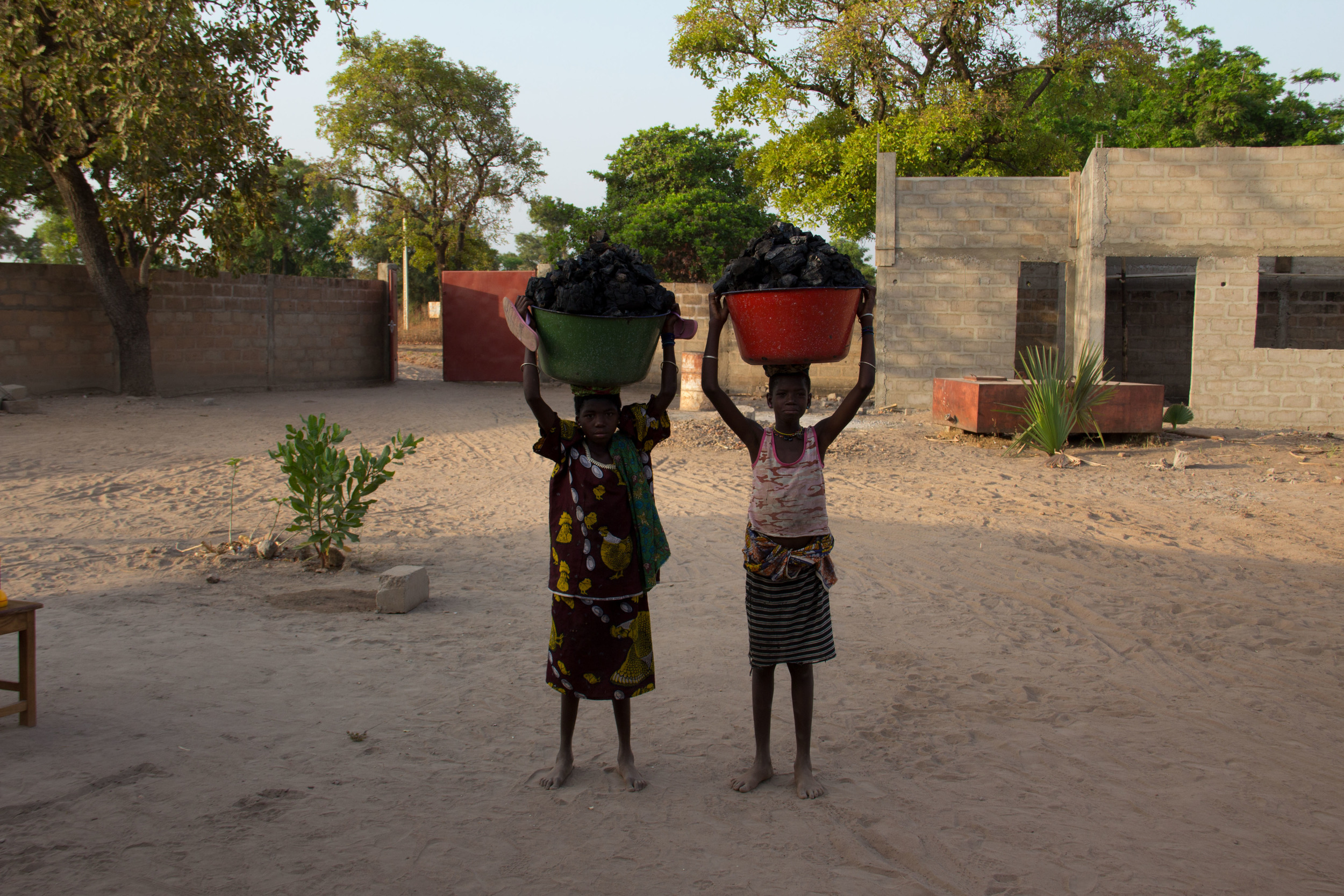 Girls selling charcoal