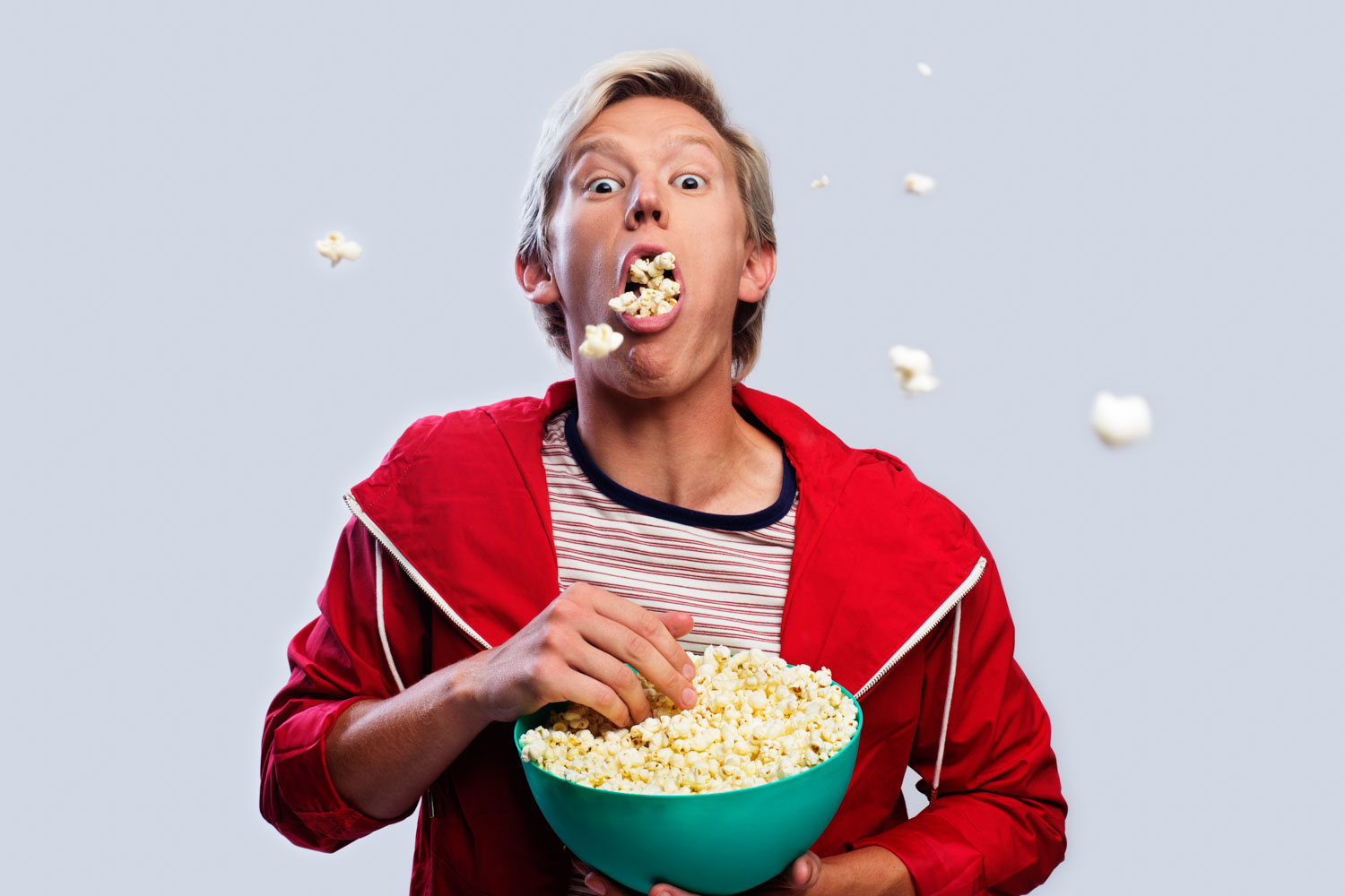 Man spitting out popcorn