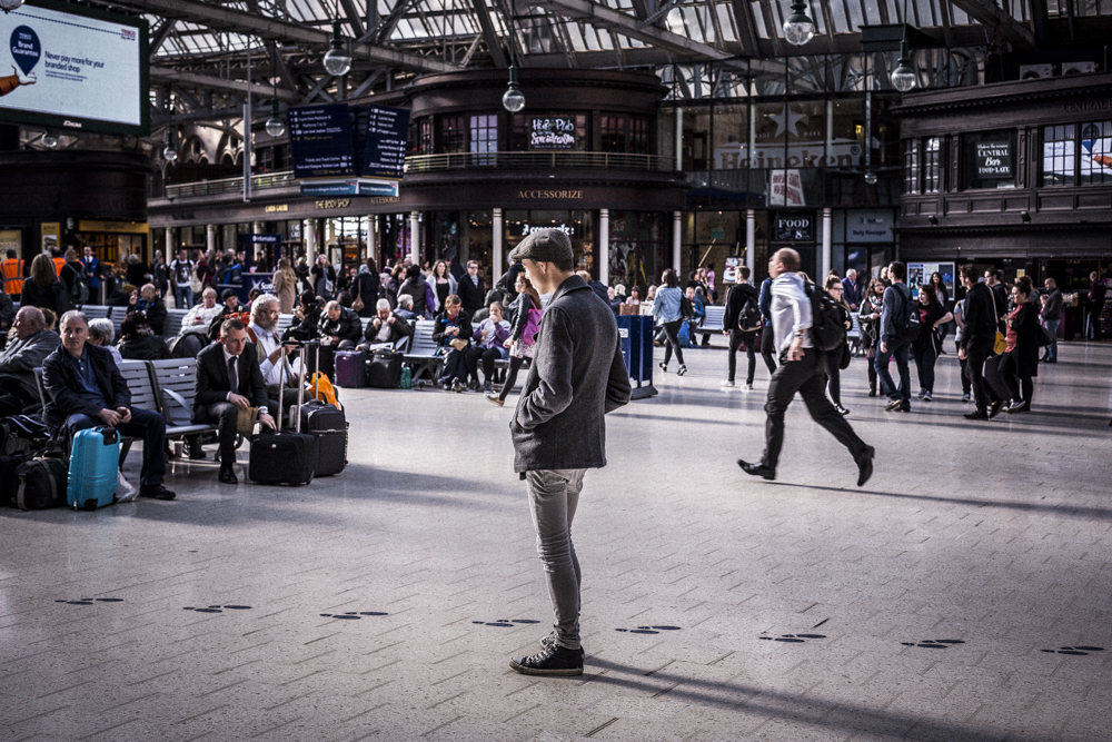 Man stands in Glasgow train station_spid pye_B6C1893.jpg