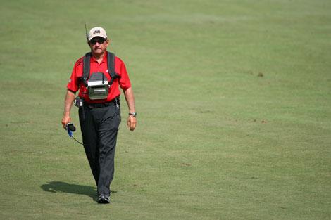 Peter Kostis walks the fairways as a golf analyst for CBS Network.