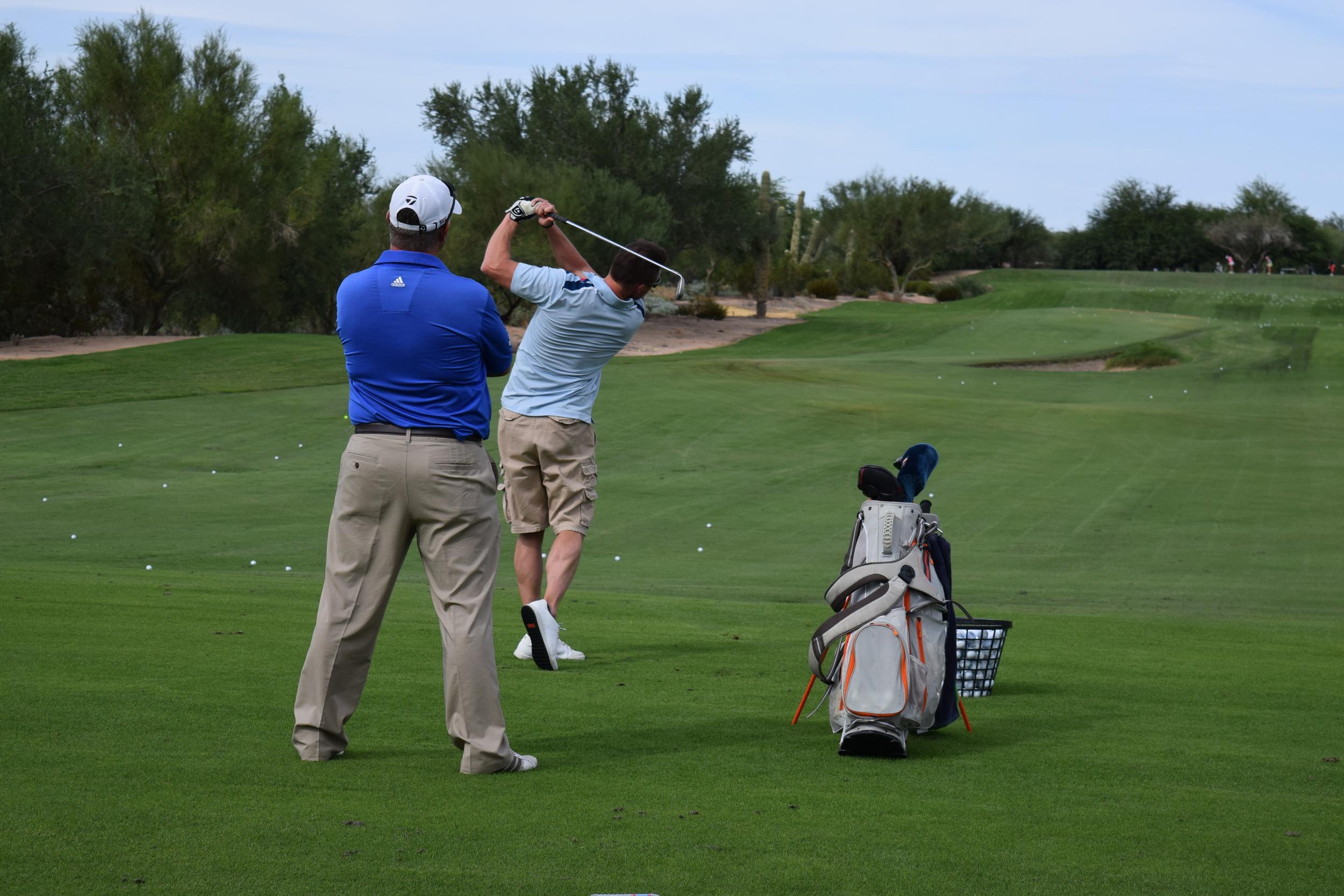 Jeff Yurkiewicz helps instruct a student during a half day golf school at Grayhawk Golf Club in Scottsdale, AZ.