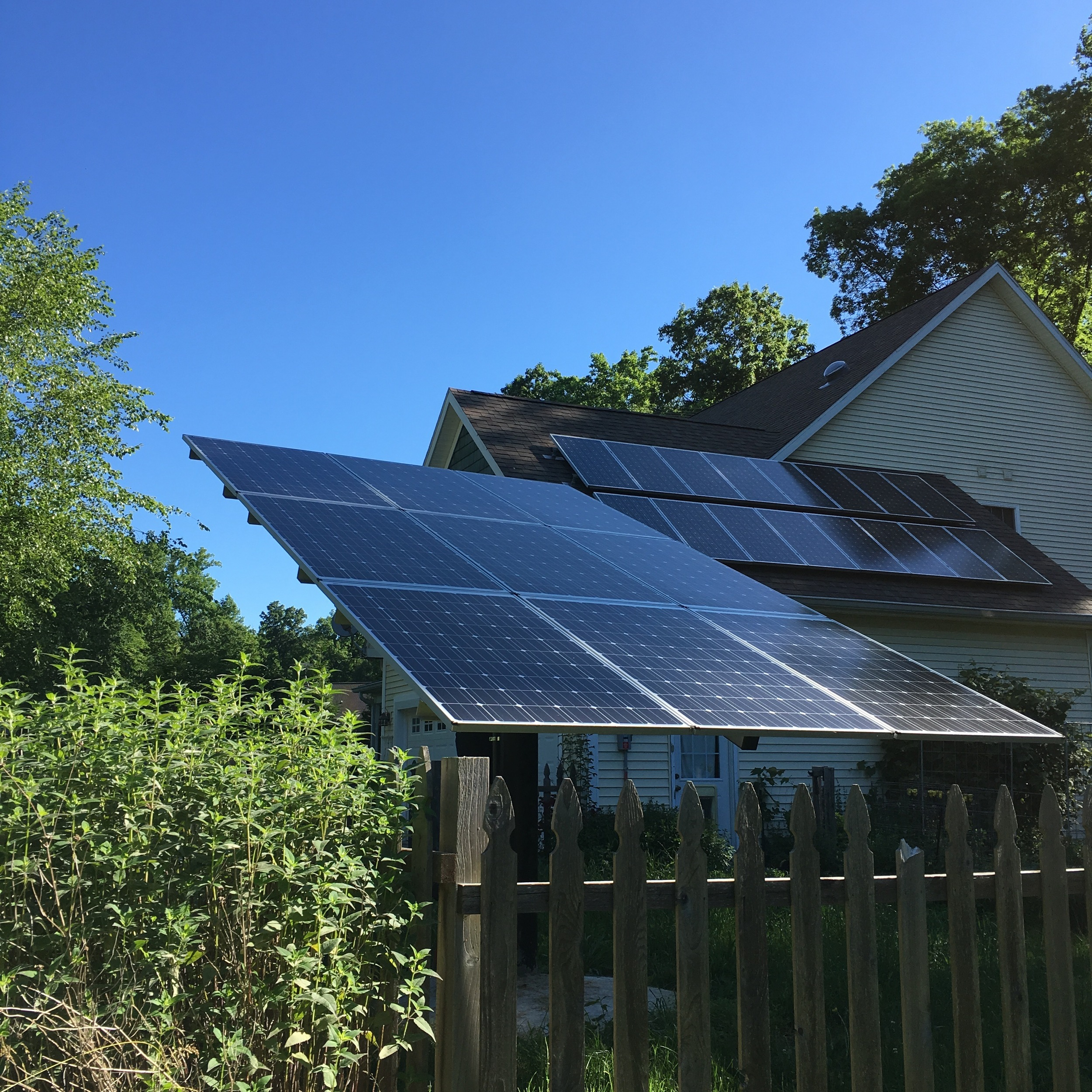 5.65 KW roof and adjustable ground based array net zero residence