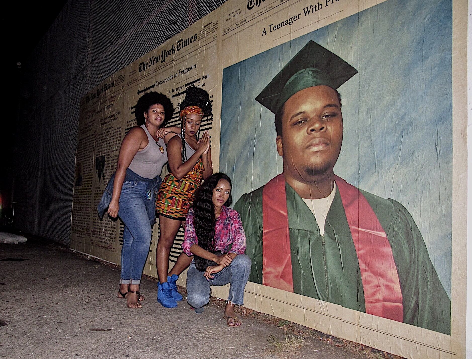 """paying respect to Michael Brown at Afropunk Fest, Brooklyn.  ...""""the walls, the bars, the guns and the guards can never encircle or hold down the idea of the people"""". Huey Newton"""