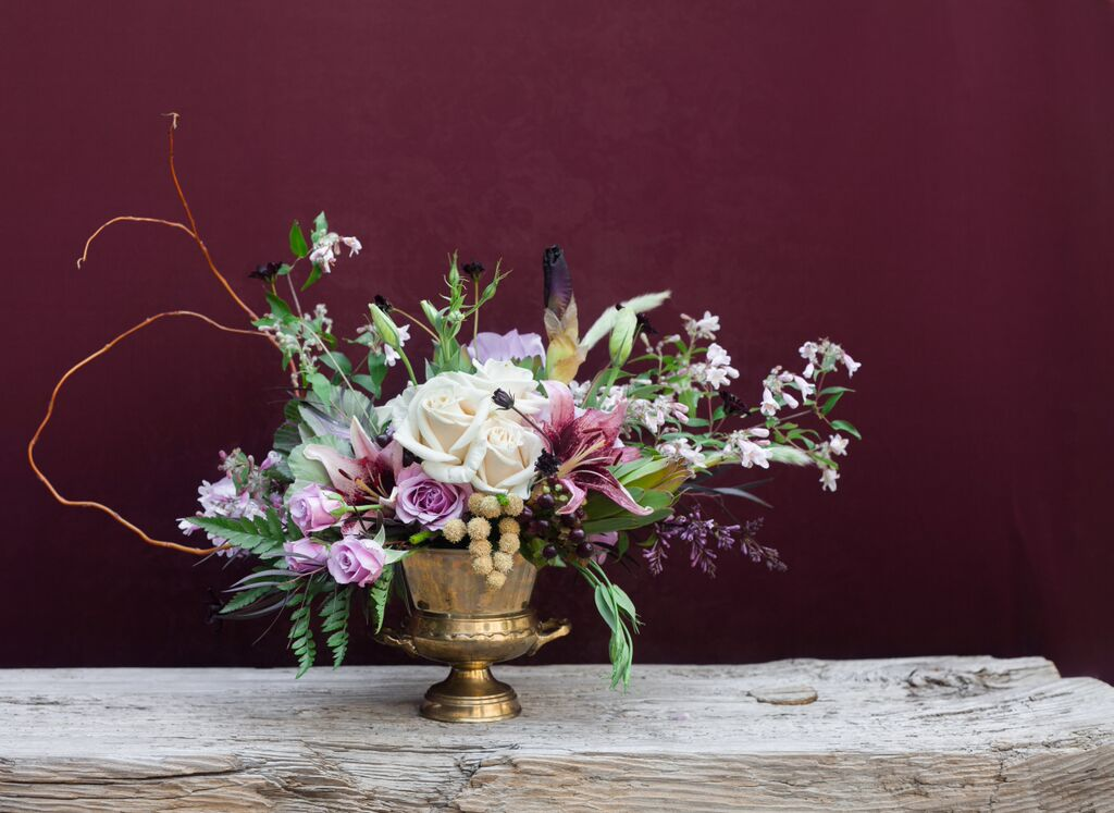 Lavender Flowers in Gold Urn