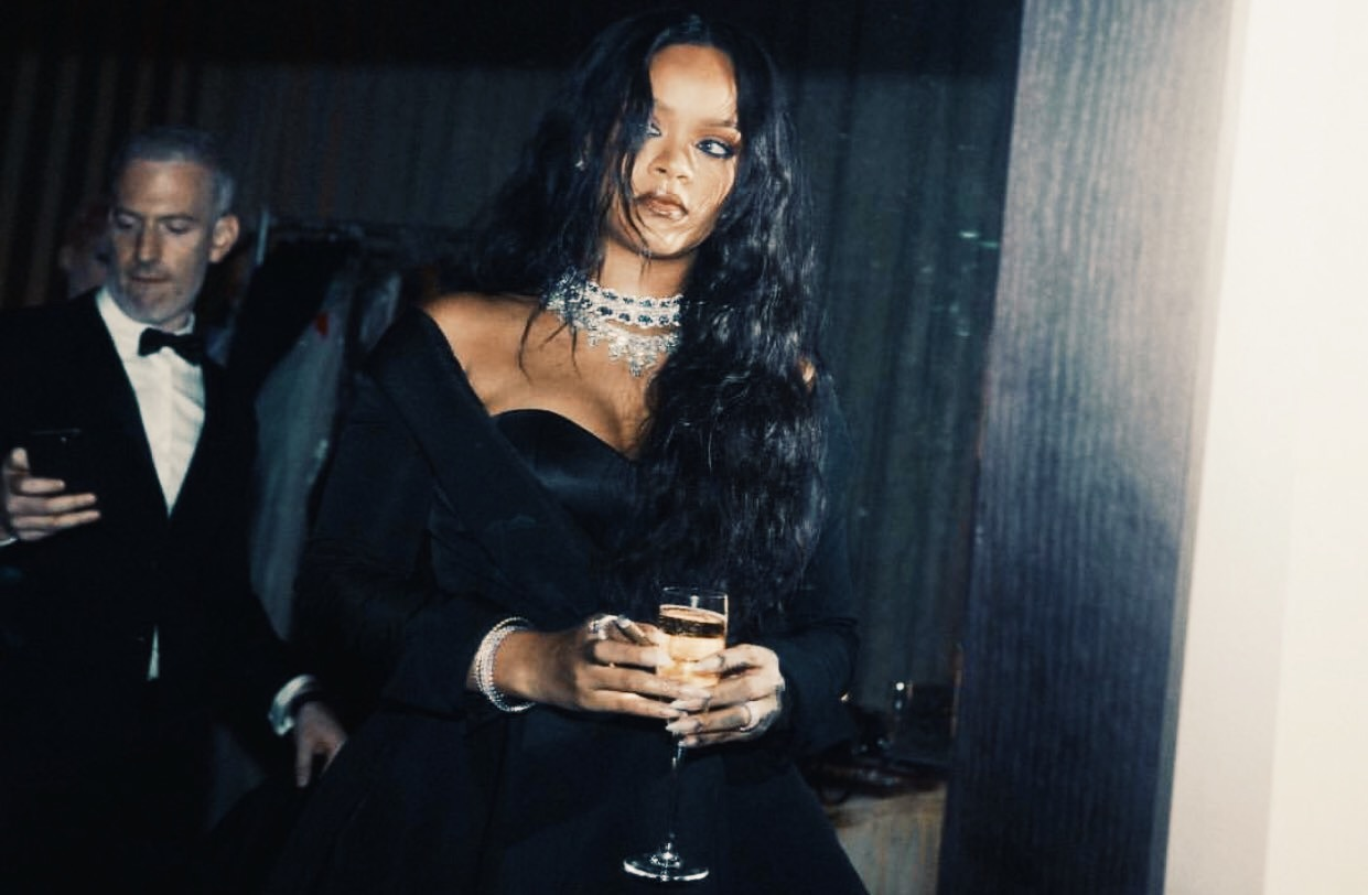 Rihanna enjoying a blunt and a glass of wine at her Fenty Beauty launch.