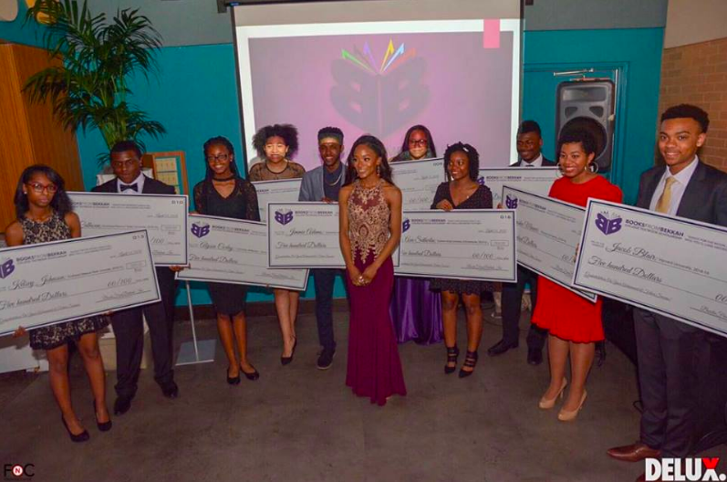 Dr. Johnson and the winners of this years scholarship(s). Photo courtesy of Delux Magazine.