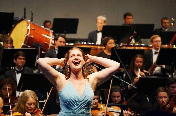 """Ann Fogler performing """"una voce poco fa,"""" with AIMS' Festival Orchestra; 2019."""