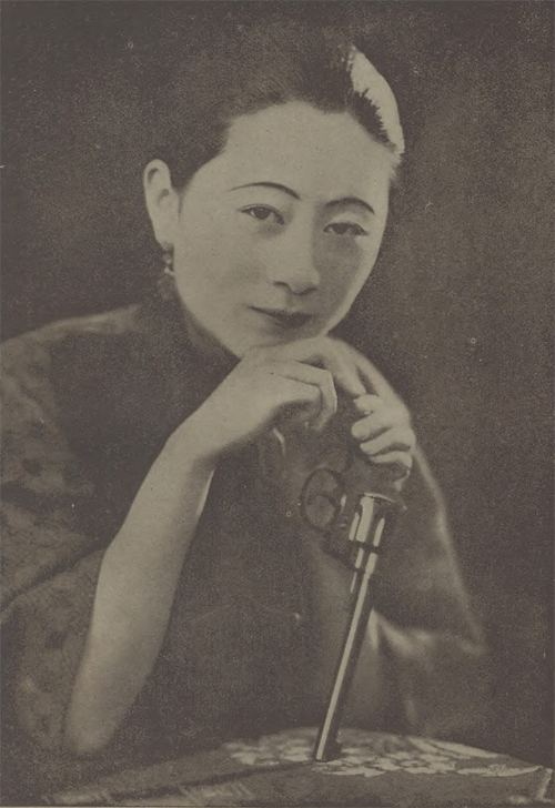 Mrs. Li Junseng, winner of first honor in the pistol shooting competition of Shanghai Revolving Association in May 1928.