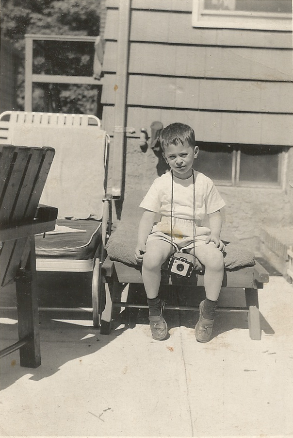 Age 5, with Brownie.