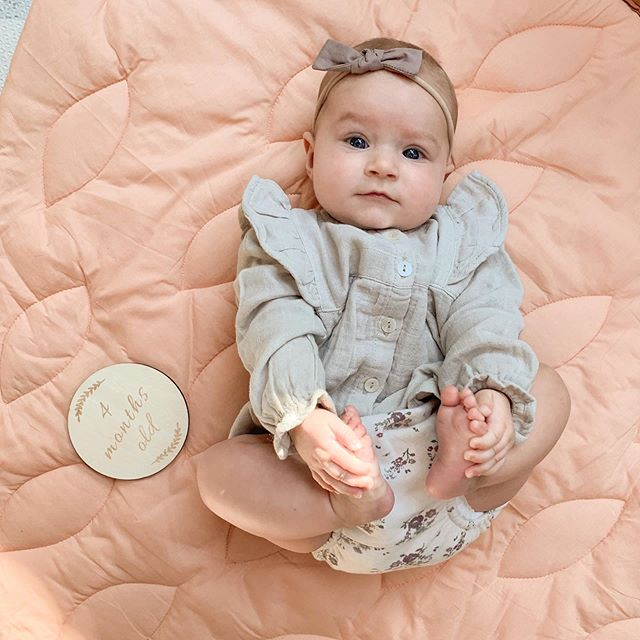 Eliza is 4 months old! She is 2nd percent for height and 20th for weight at 12 lbs 8 oz. Girly rolled over from back to belly last night which means we need to stop swaddling and we are NOT ready to stop swaddling. 😬 She can giggle, loves grabbing her toes, is extremely curious about eating food but hasn't yet and is great at tummy time. She went to Disney World last week and adores her Daisy Duck stuffed animal. Eliza is just the sweetest and snuggliest baby and we love her more with every day.