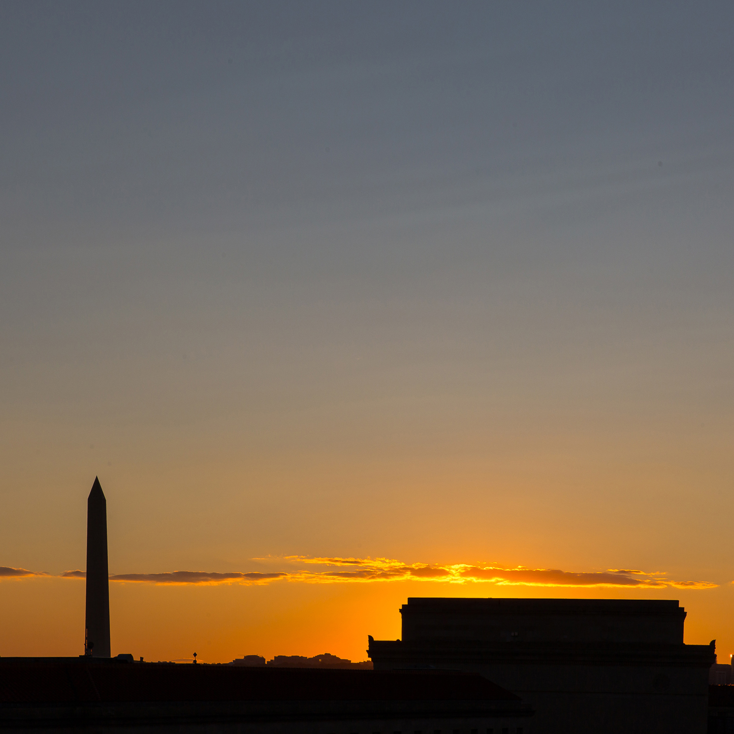 Washington Monument and National Archives at sunset