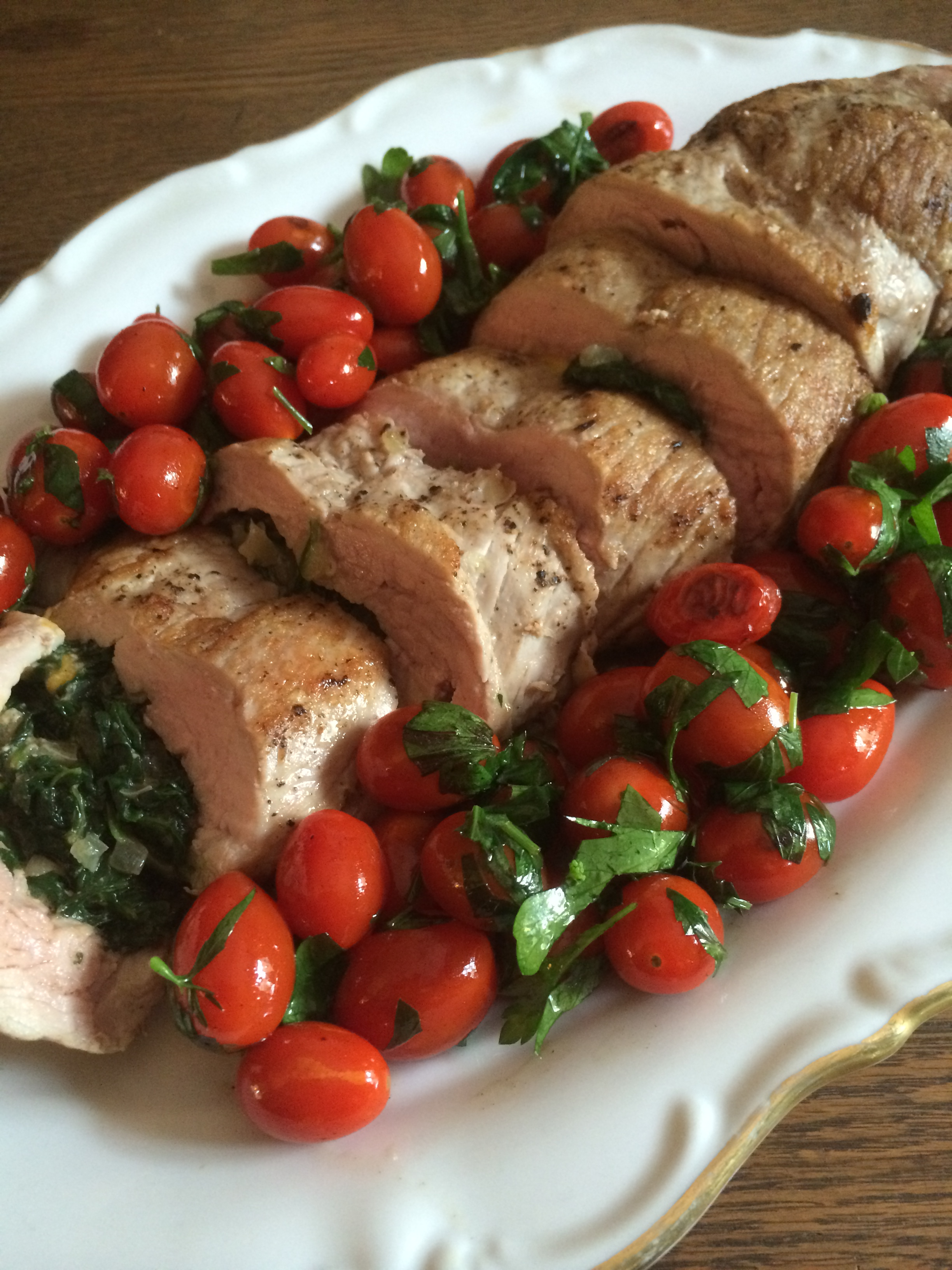 Stuffed Pork Tenderloin on Grape Tomatoes