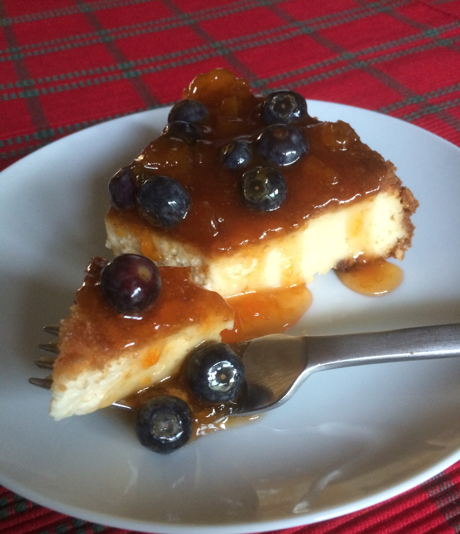 Cheesecake with Apricot-Blueberry Sauce
