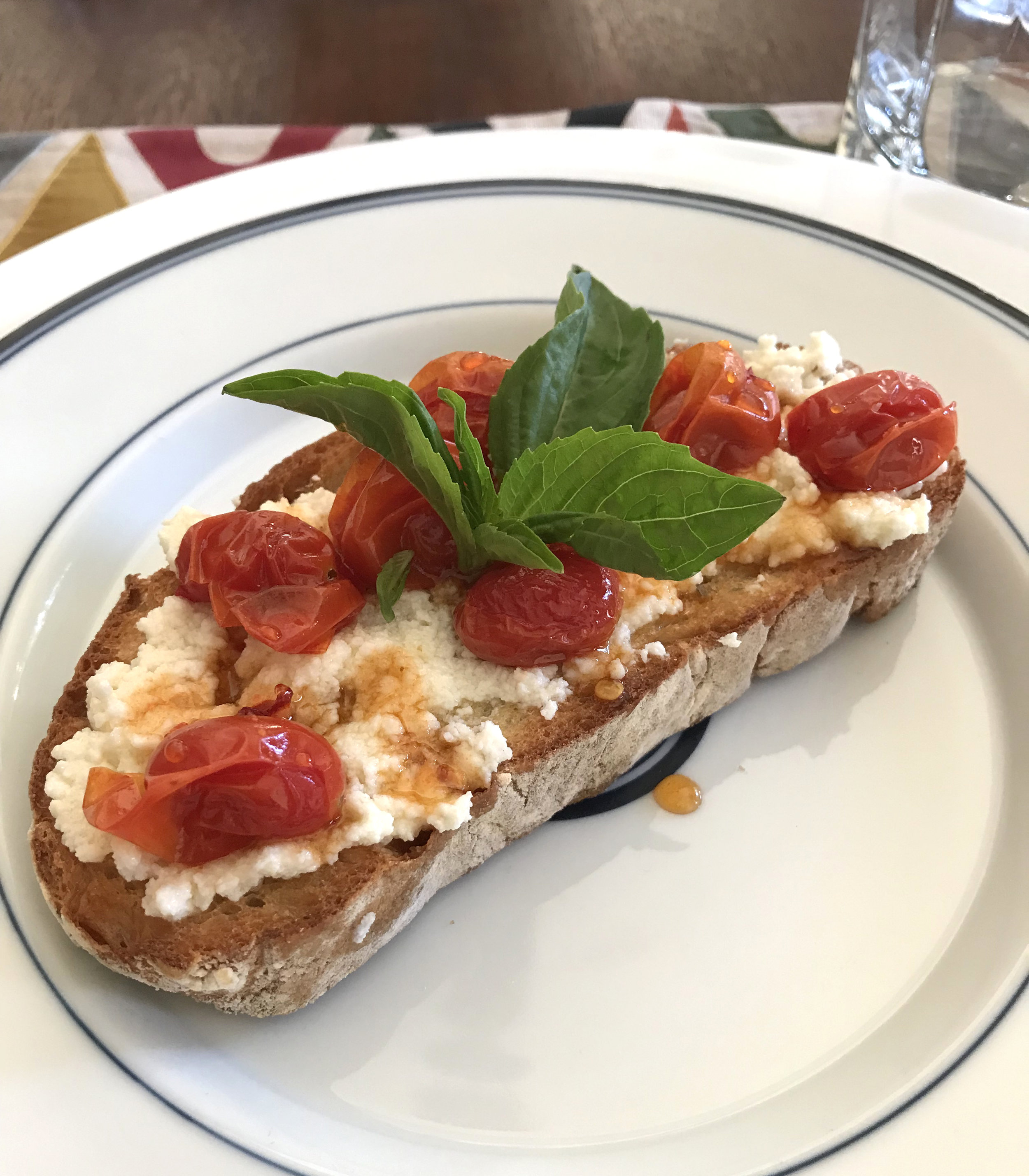 RICOTTA BRUSCHETTA WITH ROASTED TOMATOES & SPICY HONEY