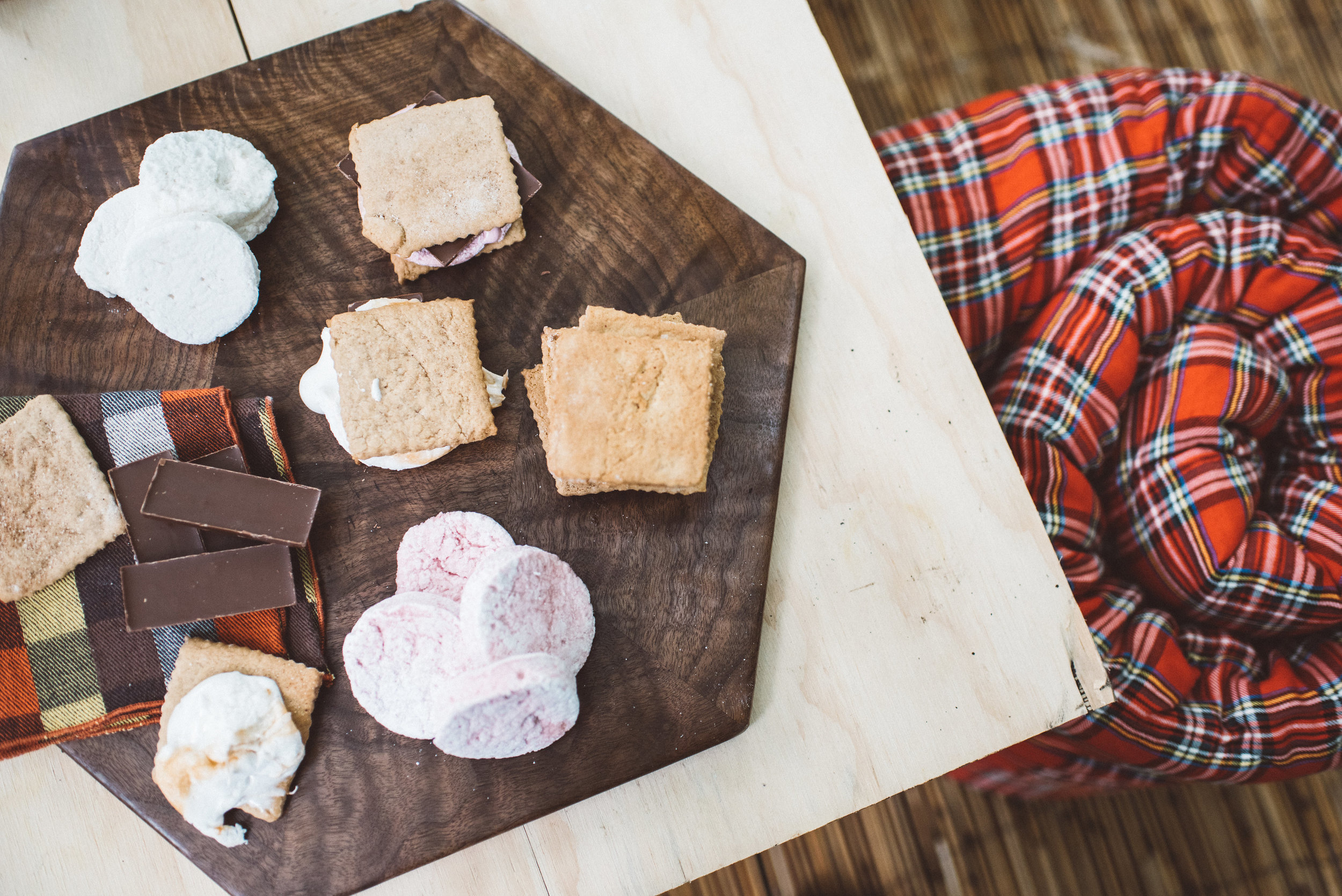 Shown: Marshmallows by Olivia Rose (coming soon to the Flea) and hex cutting board by Three Hex Studios. Sleeping bag from Great Lake Outfitters.
