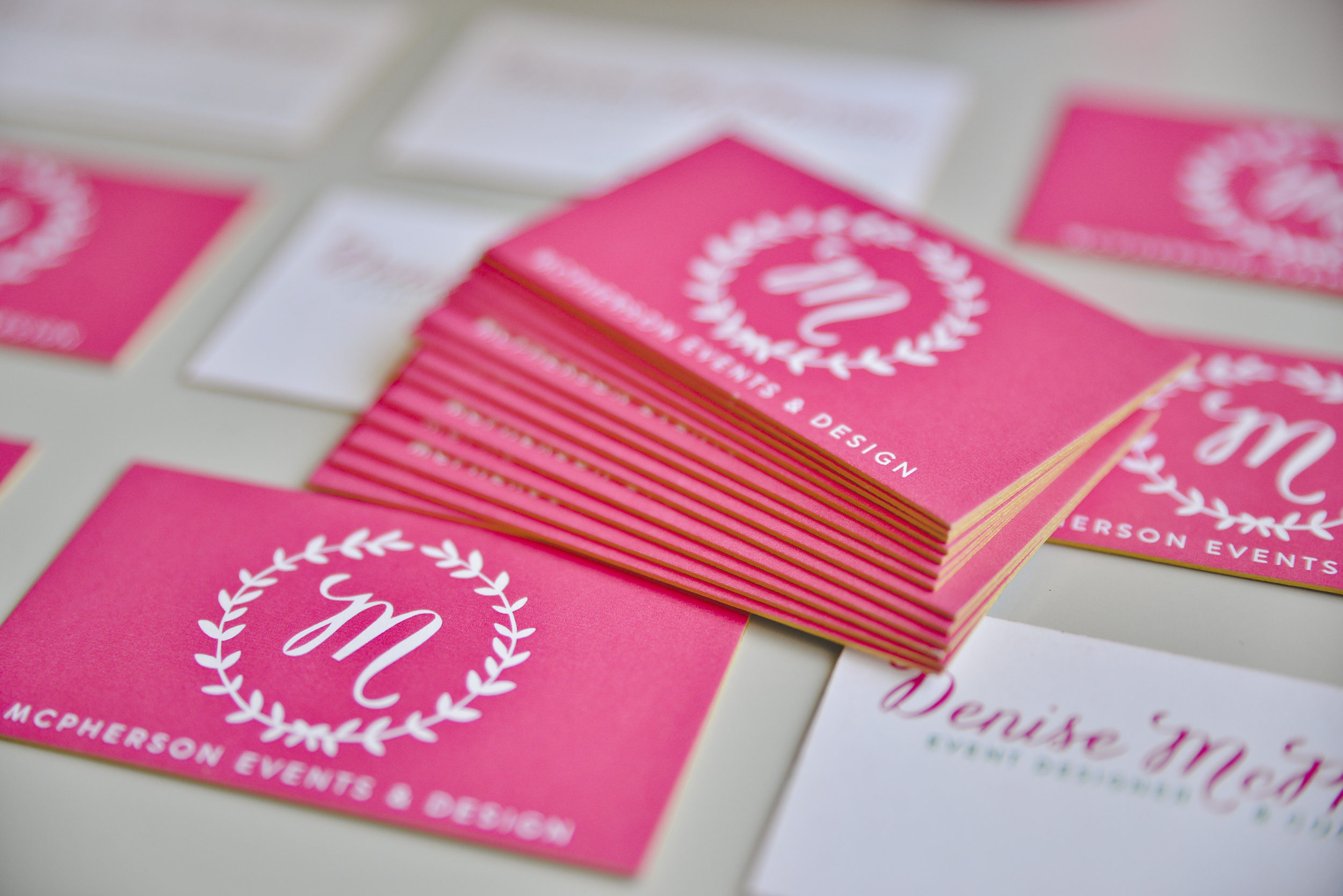 McPherson Events & Design super thick & luxurious business cards with GOLD edges.