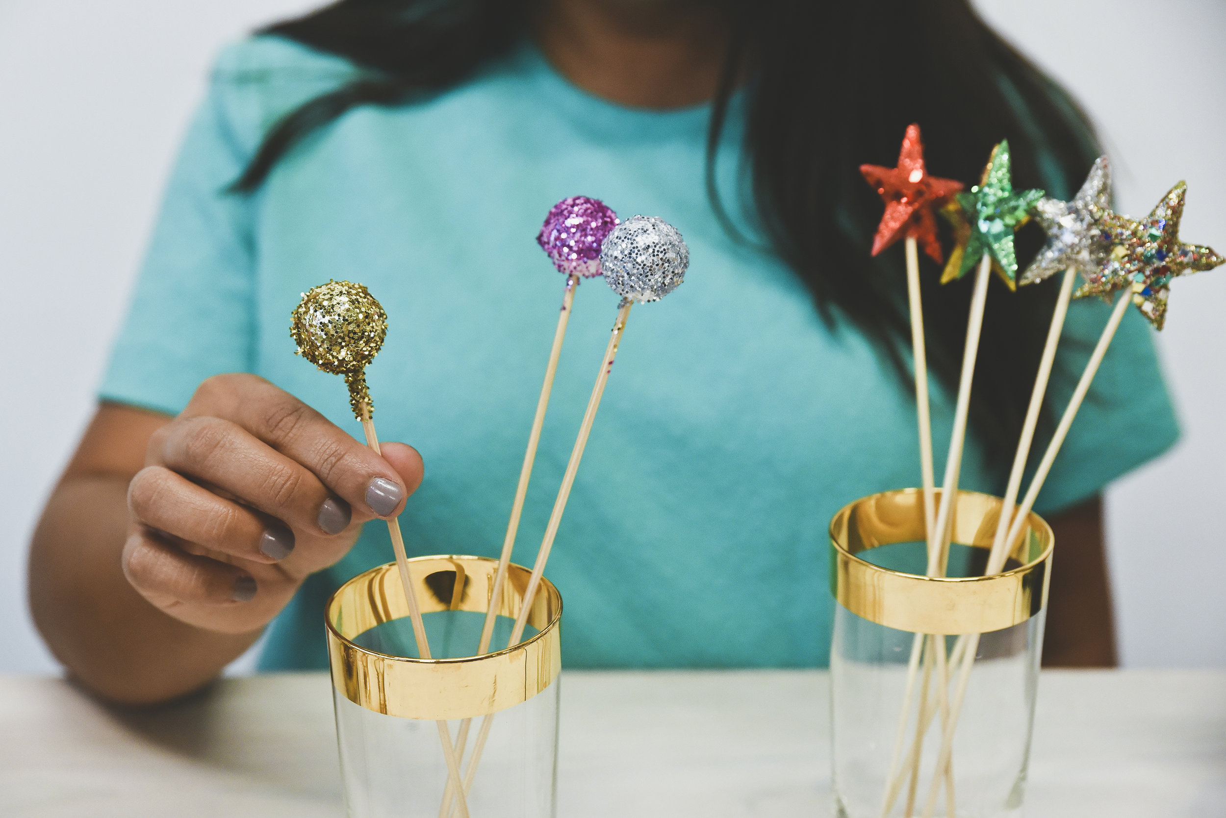 Star swizzle sticks from All Things For You and dress from Ode Vintage