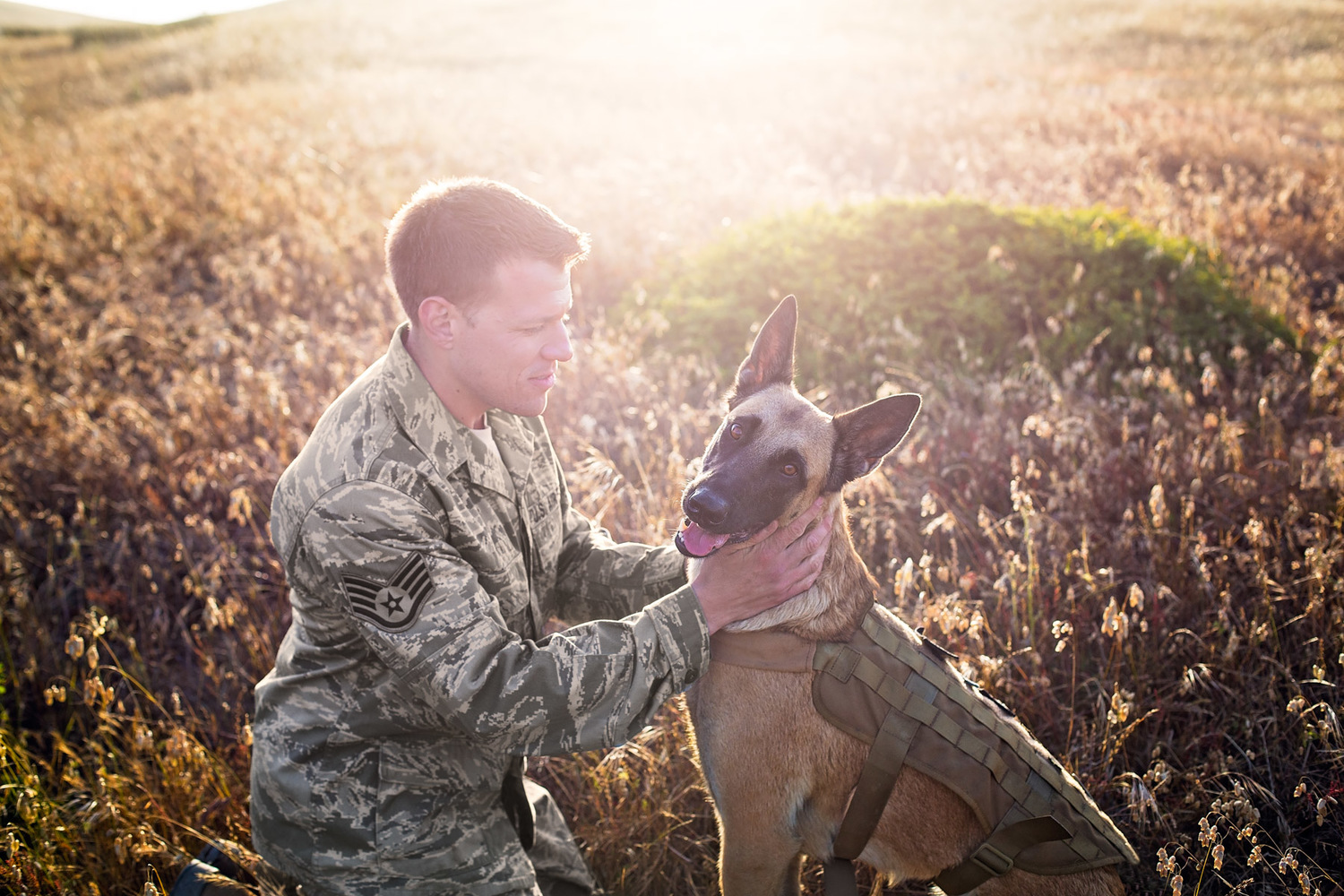 Military man and his working dog.