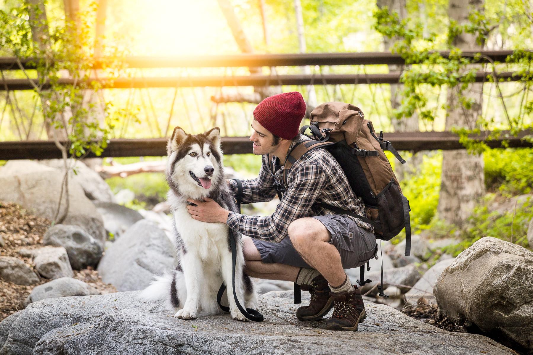 husky-dog-and-man-on-river-hike-woods-together-dog-photography.jpg