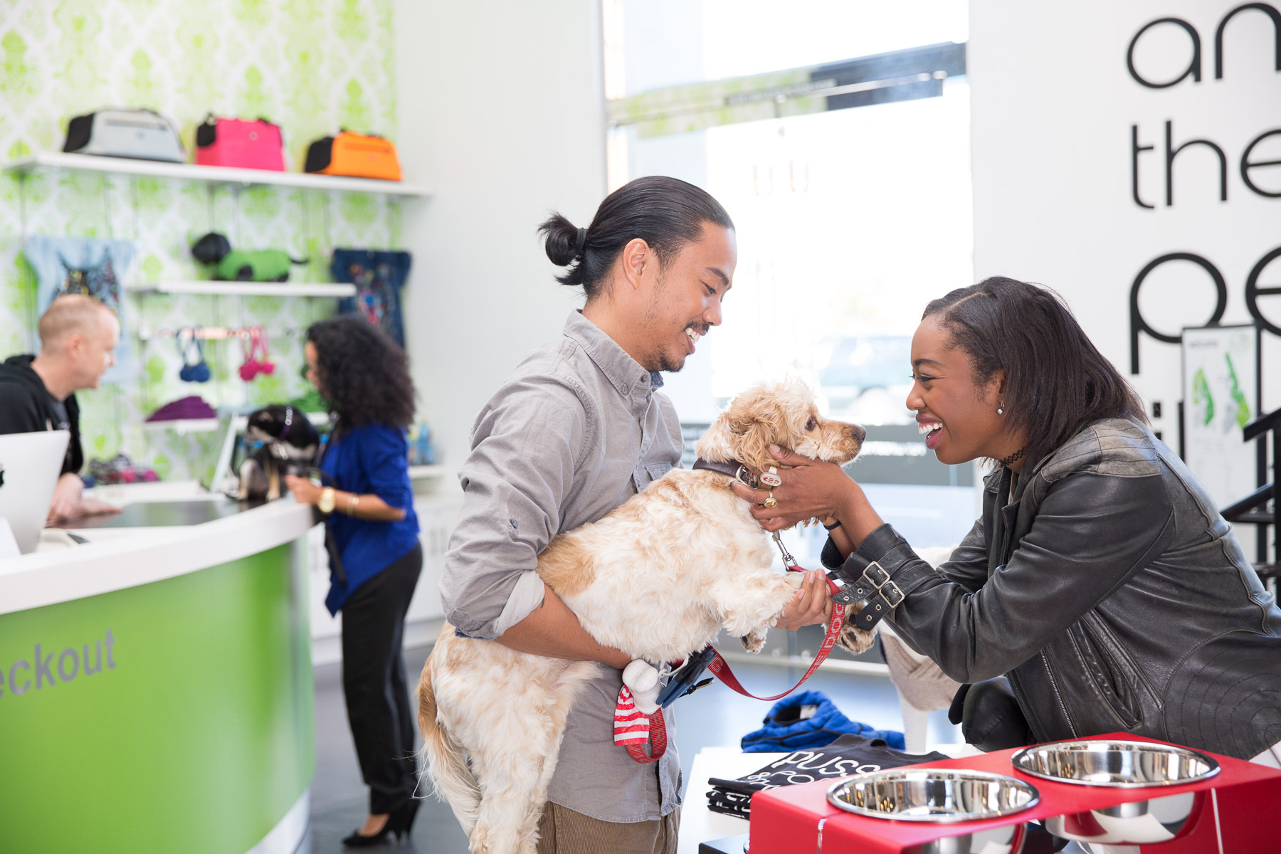 couple-shopping-with-dog-at-pet-store.jpg