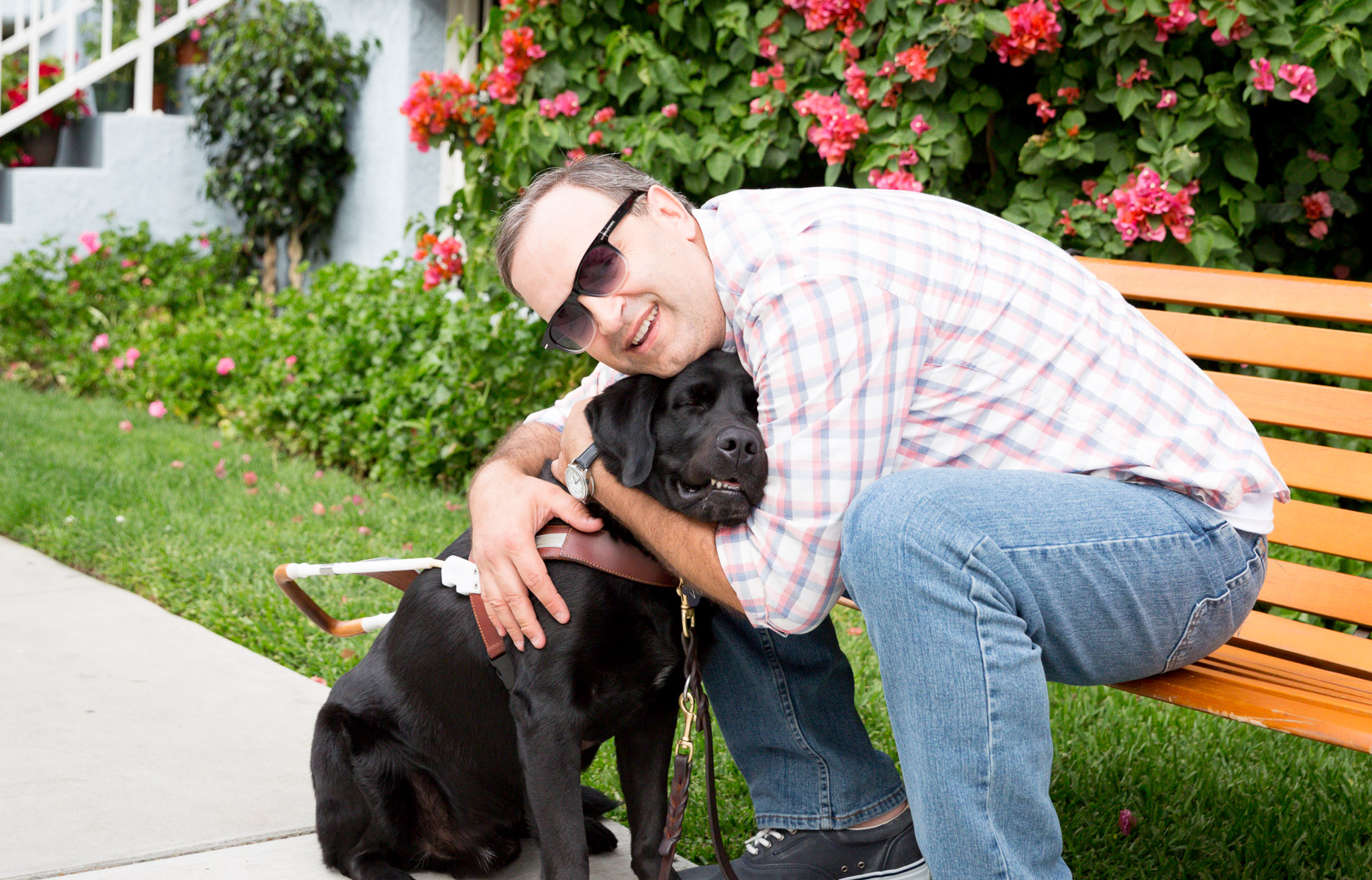 visual-impaired-man-with-his-guidance-dog-hugginh-black-labrador-pet-photography