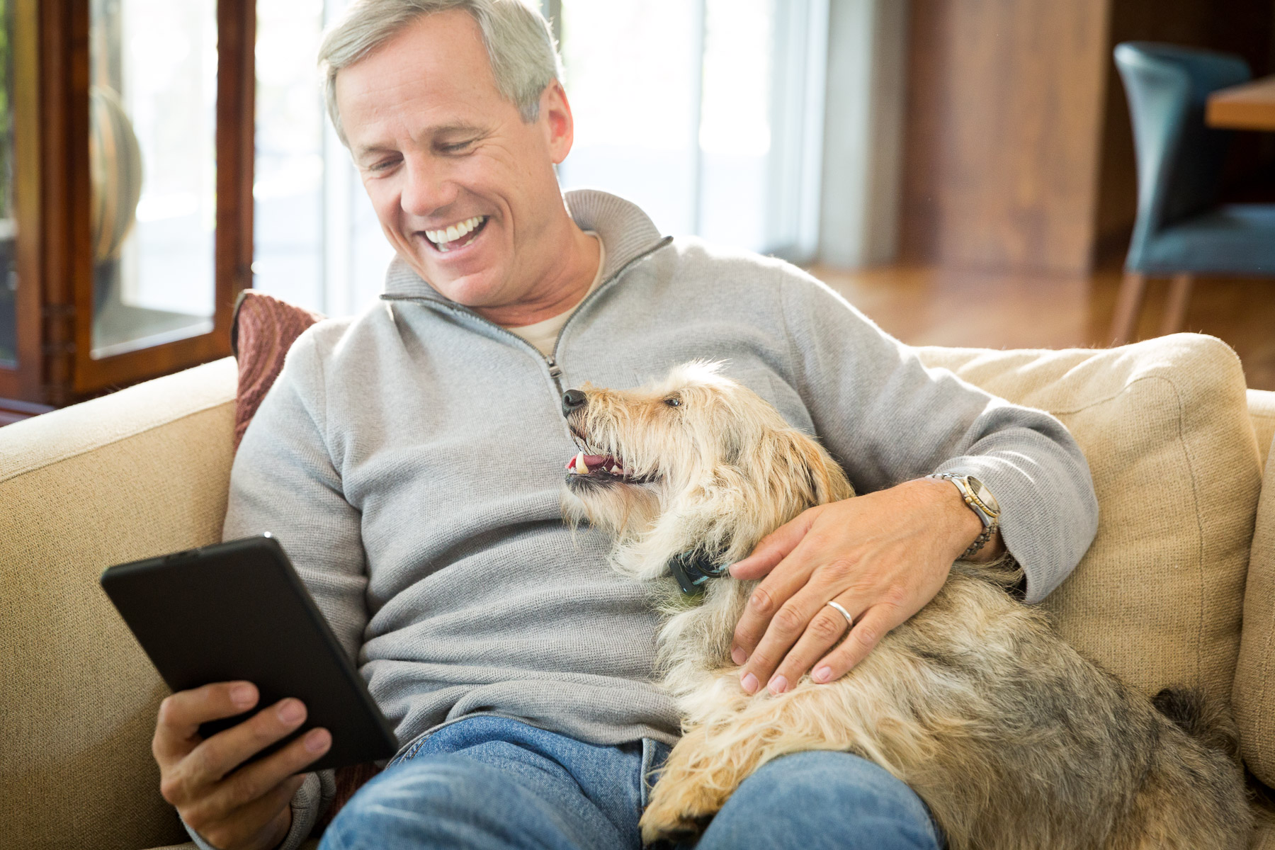 attractive-man-with-dog-reading-couch.jpg