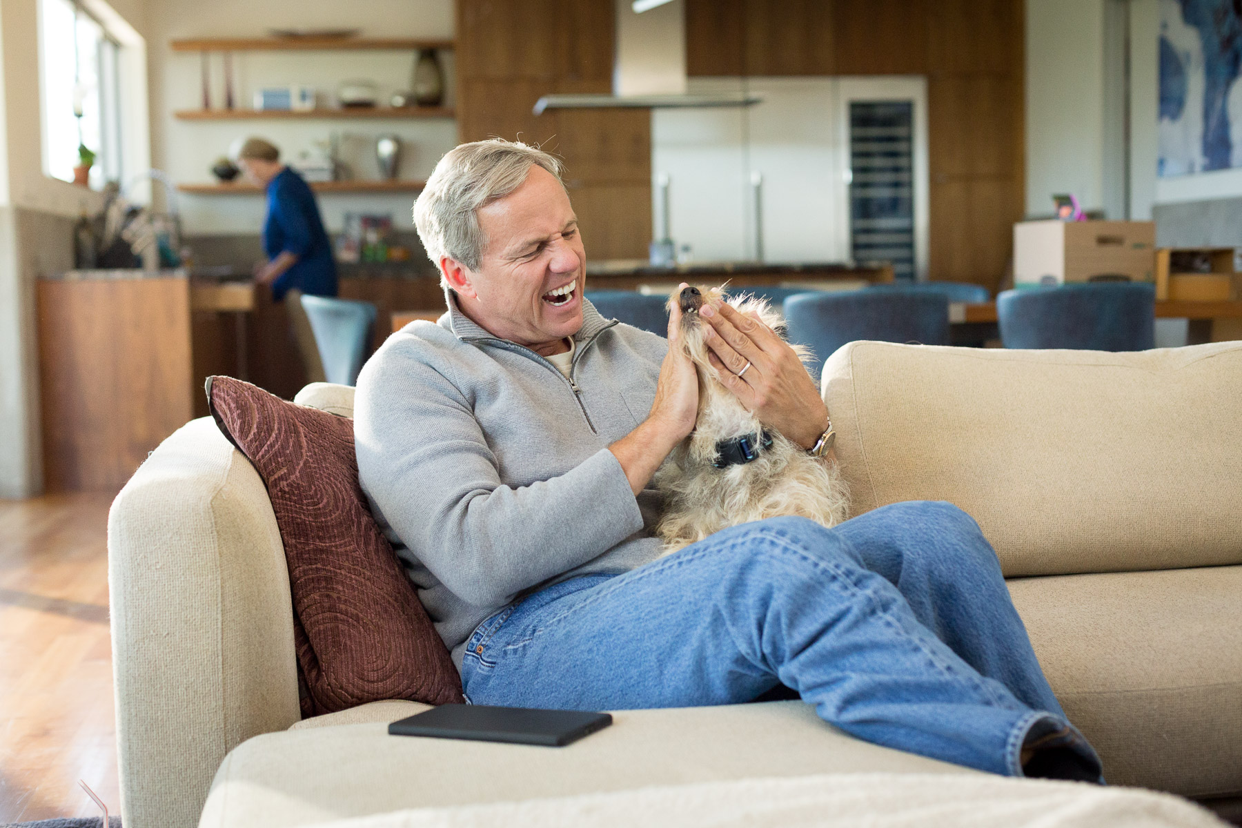 man-playing-with-mutt-dog-at-home.jpg