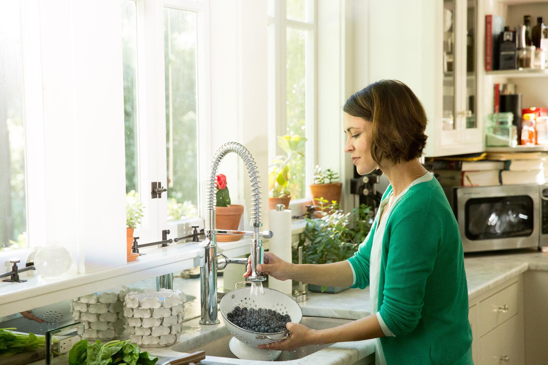 woman-preparing-organic-food-kitchen.jpg